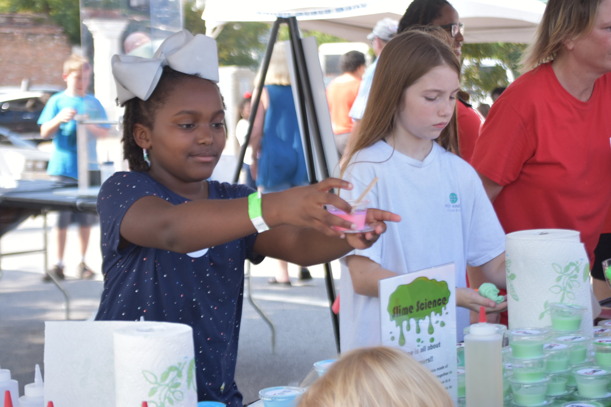 "Sumter students learned about ""slime science"" during the event on Saturday downtown."