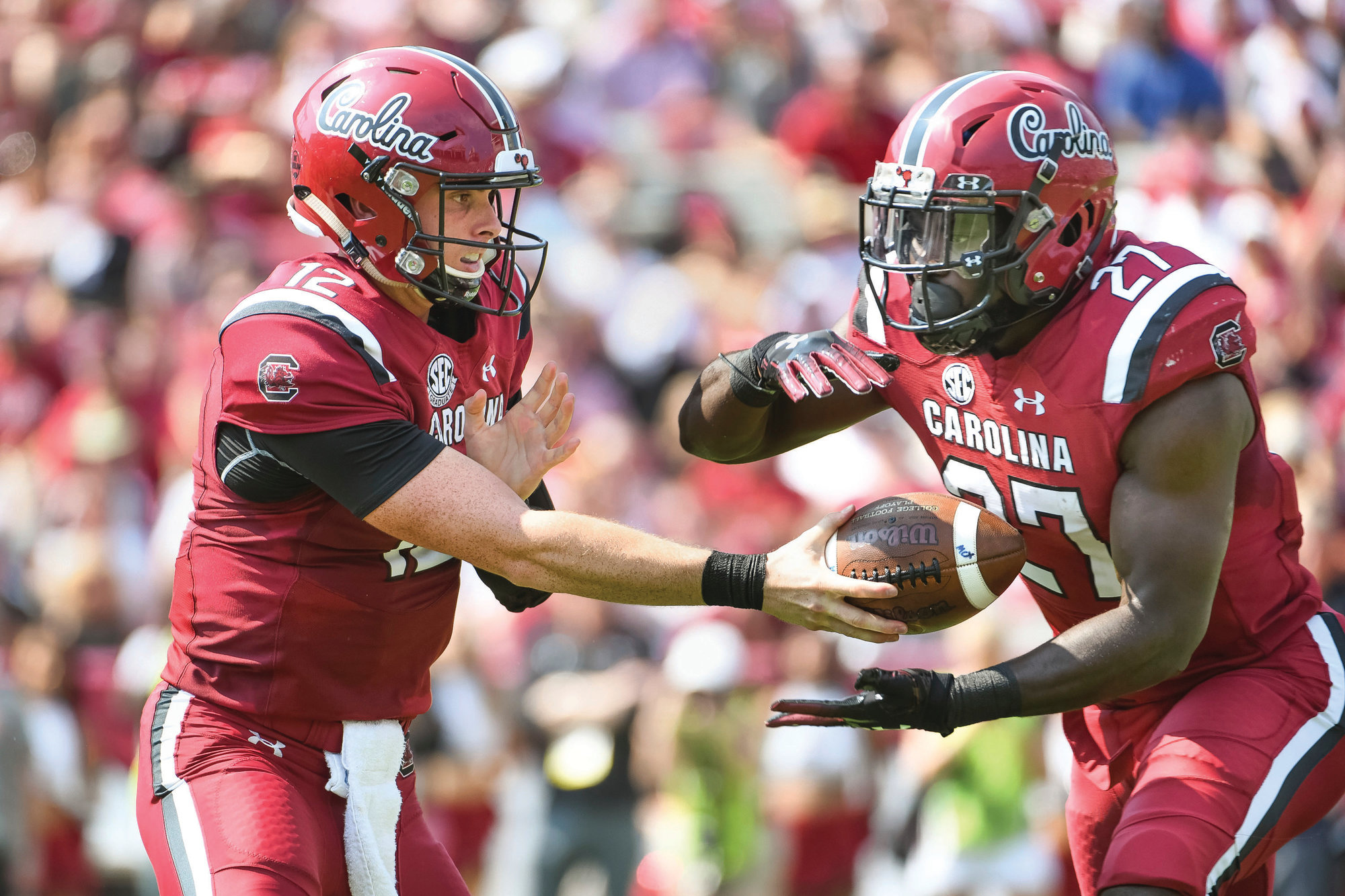 THE ASSOCIATED PRESS South Carolina quarterback Michael Scarnecchia (12), shown handing the ball off to running back Ty'Son Williams in the Gamecocks' 37-35 victory over Missouri on Saturday, should get the start when USC plays host to Texas A&M this Saturday.