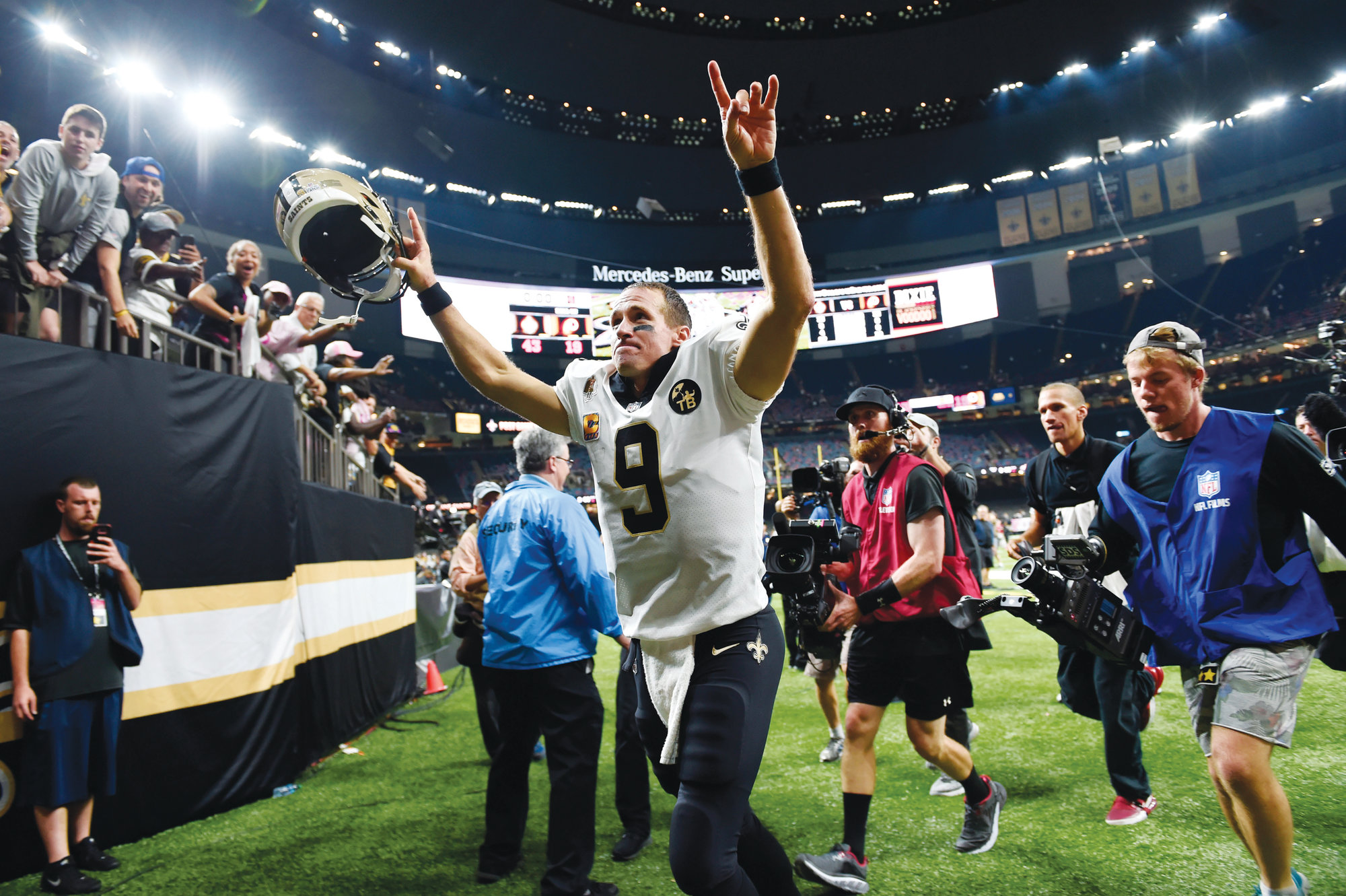 New Orleans Saints quarterback Drew Brees (9) acknowledges the crowd as he runs off the field after the Saints' game against the Washington Redskins in New Orleans on Monday. Brees broke the NFL all-time passing yards record during the game, and the Saints won 43-19.