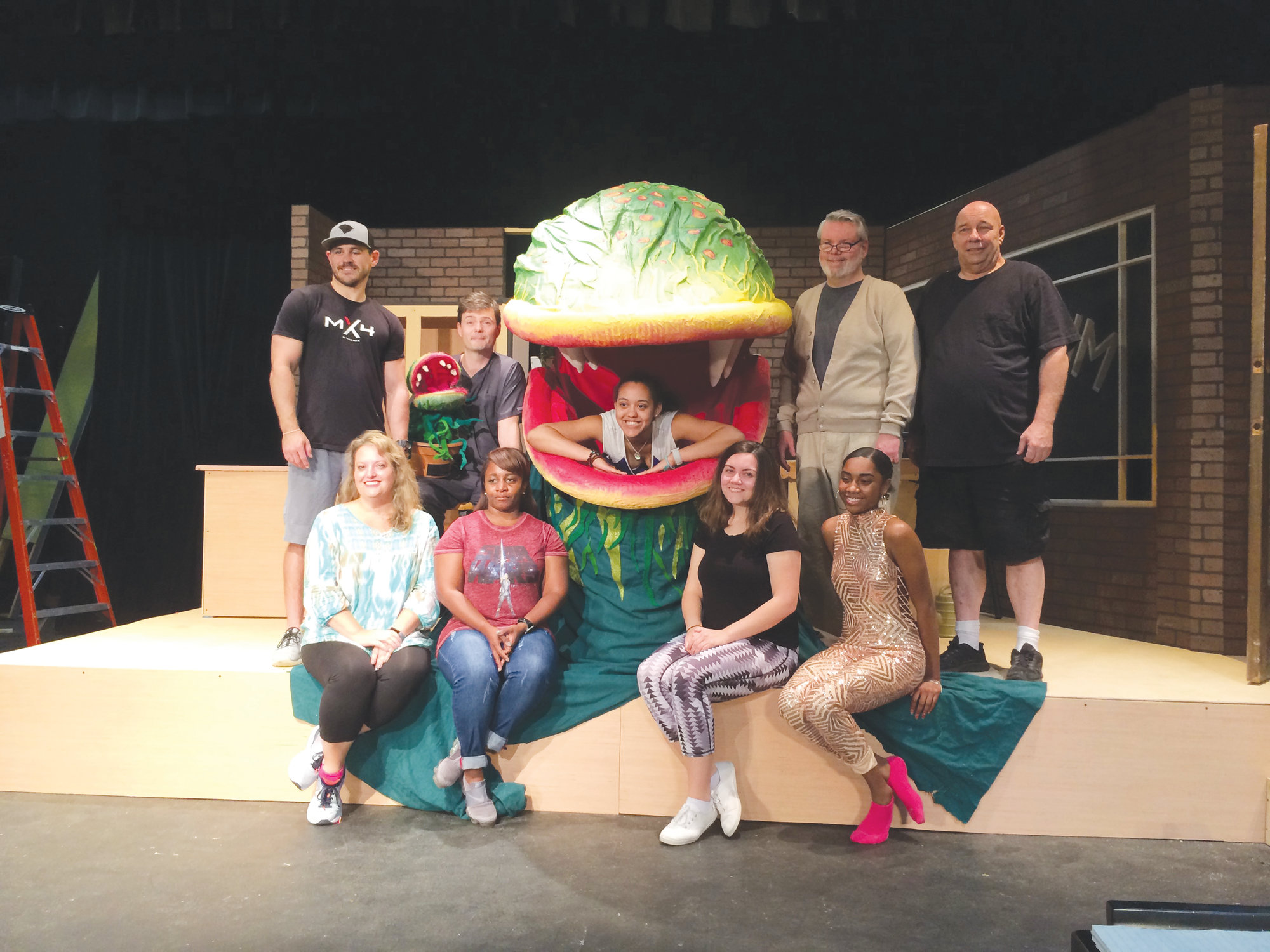 "IVY MOORE  / SPECIAL TO THE SUMTER ITEM  The cast of Sumter Little Theatre's ""Little Shop of Horrors"" pauses during a recent rehearsal for a group photo.  From left are: top row -Matt Wilt, Todd Warrick, Cierra Stewart (in plant), John Michael Osteen and David Shoemaker; front row - Alyssa Gibbs, Keonna Porter, Jaycie Wisor and Aaleyah Powell. The musical comedy opens Thursday, Oct. 18, and will run for 10 performances."