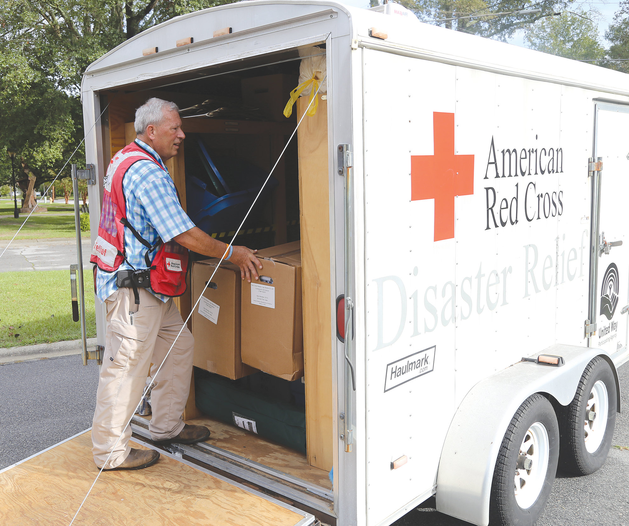 Steve Shumake, disaster action team coordinator for the area American Red Cross region, sorts through supplies in a relief trailer Wednesday outside the Sumter County Recreation Center, 155 Haynsworth St., which is open as a shelter.