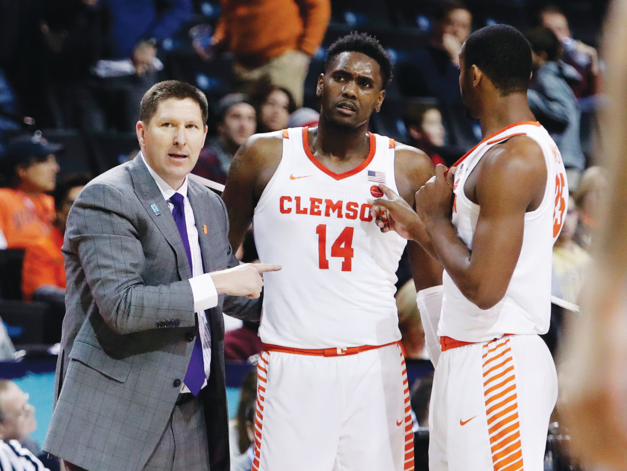 Clemson men's basketball head coach Brad Brownell, left, hopes a mixture of veterans like Elijah Thomas (14) and Aamir Simms (25) along with some talented newcomers will help the Tigers build upon the success they enjoyed last season.