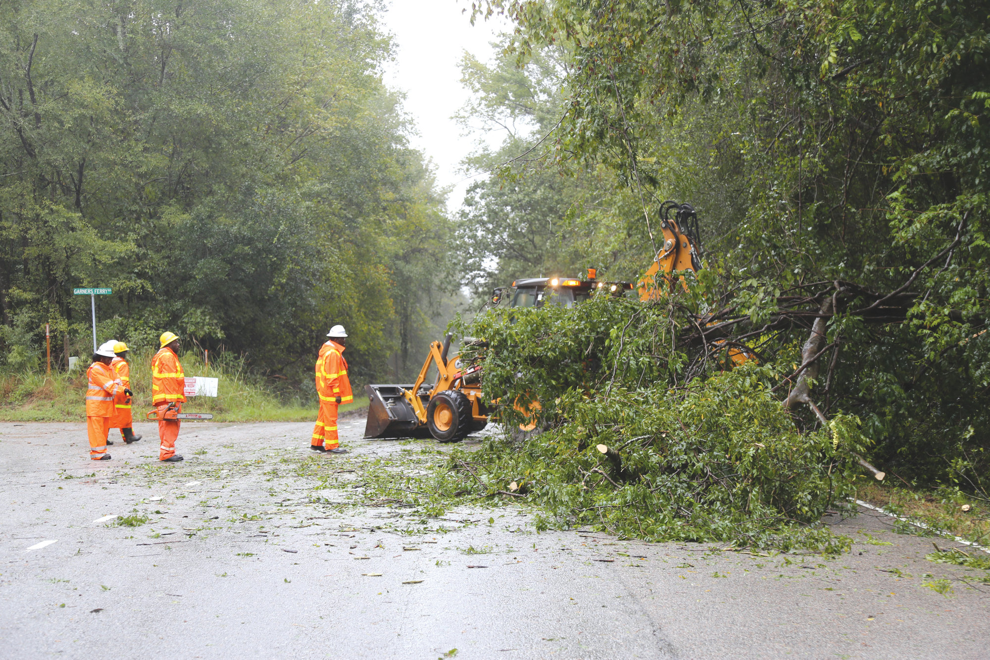 A work crew removes part of a tree that fell on North Kings Highway/S.C. 261 on Thursday.
