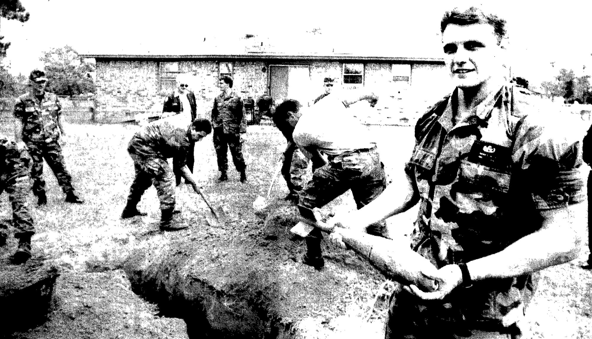 1993 - Staff Sgt. Stephen Miller holds the practice bomb recovered from the backyard of Joe and Charlene Baker as other Shaw Air Force Base airmen fill in the hole. No one was injured after the bomb was accidentally dropped from an F-16.