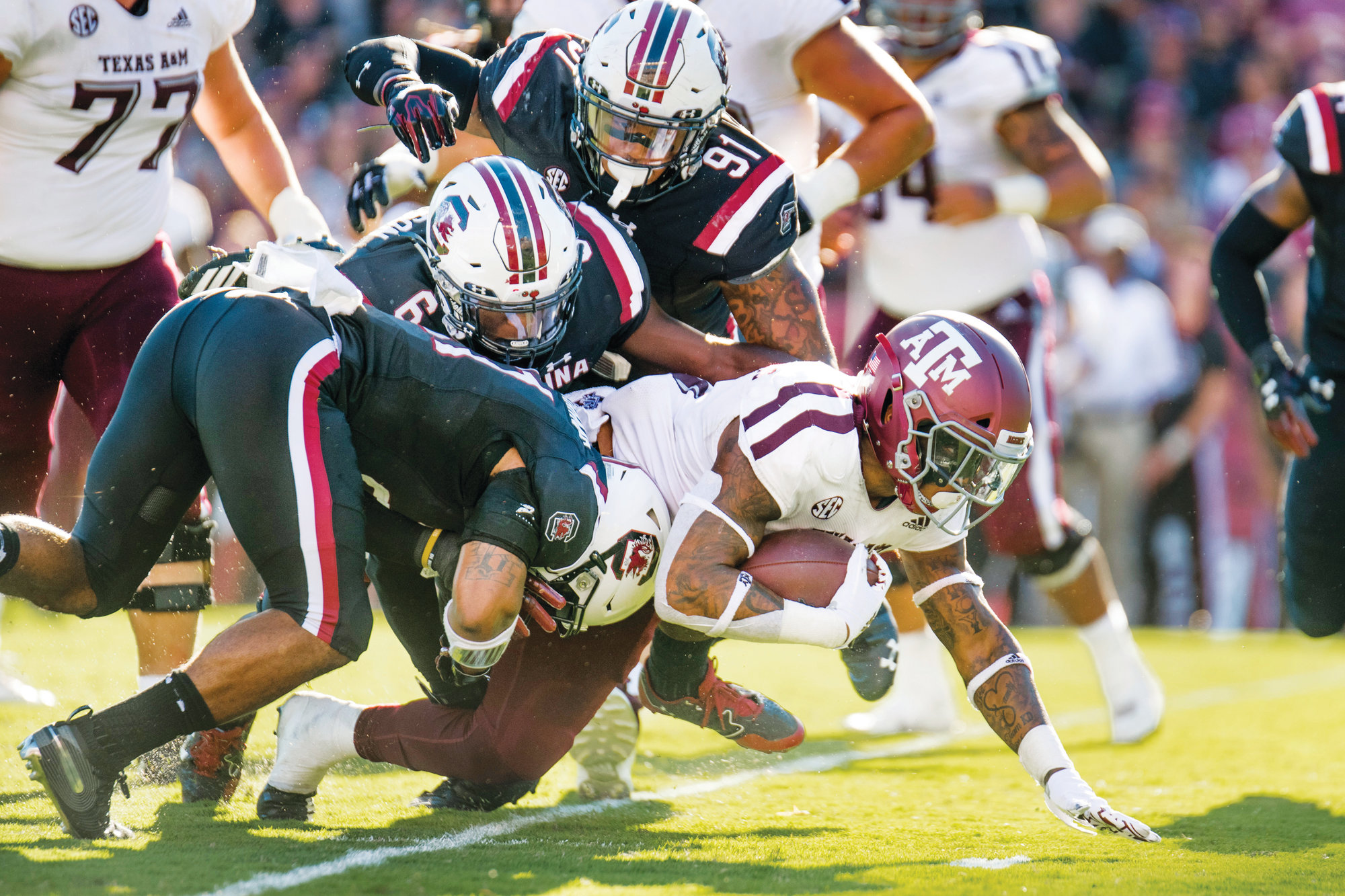 THE ASSOCIATED PRESS  Texas A&M running back Trayveon Williams (5) fights for yardage against the South Carolina defense during the Aggies' 26-23 victory on Saturday at Williams-Brice Stadium in Columbia.
