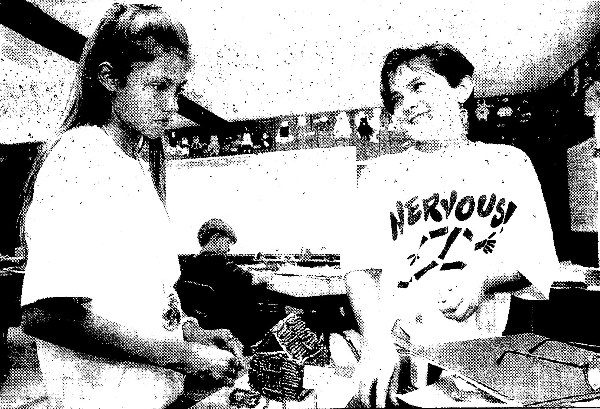 "SUMTER ITEM FILE PHOTO  1993 - Sixth-graders Crystal McDowell, left, and Ann Douglas talk about the concept of their ""pig house"" - which has a loft for guests - that was designed as part of a gifted and talented class taught by Leslie Roberts. Students were creating a lifestyle for pigs in a fun exercise to expand their thinking process."