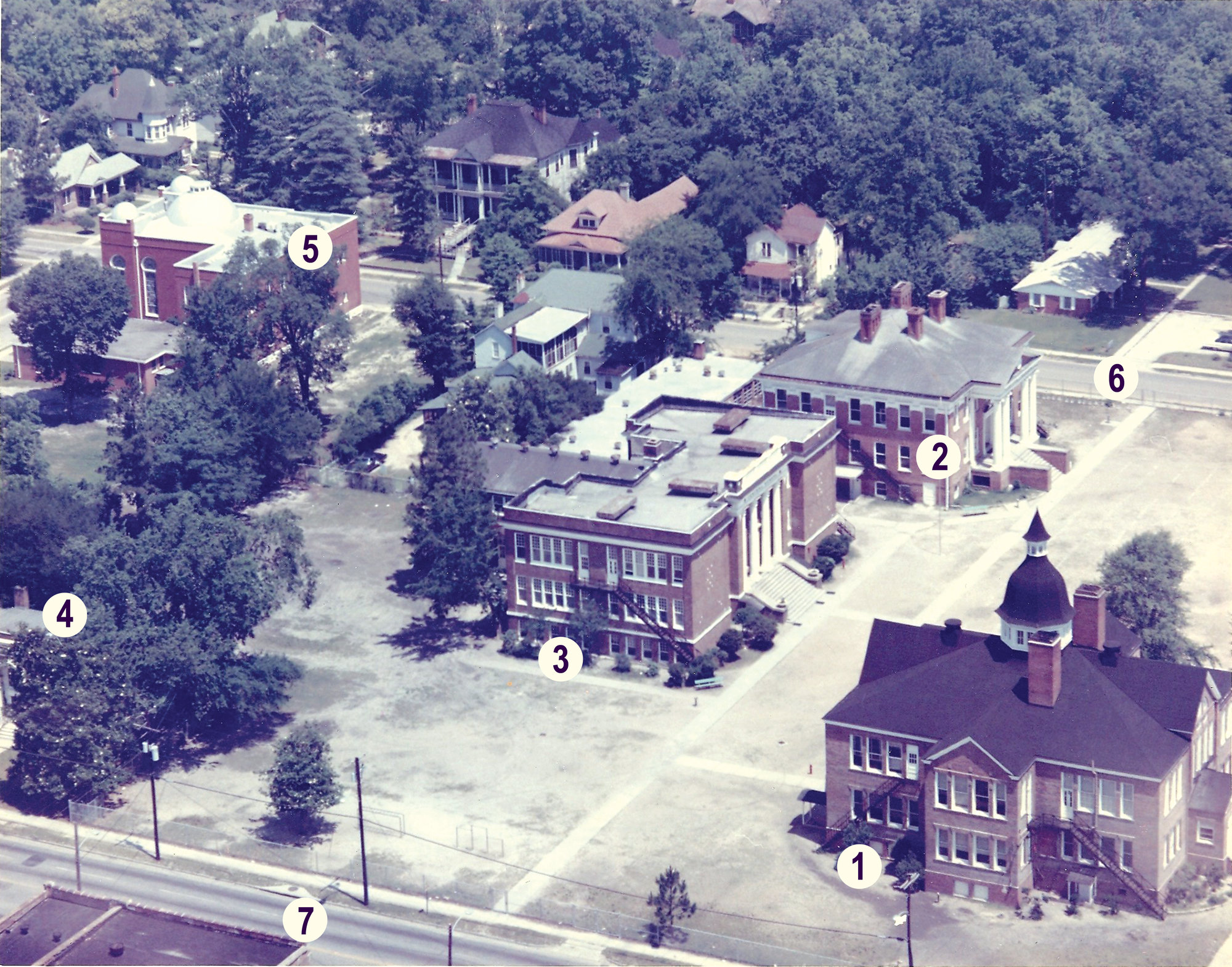 This overhead photo looking northwest shows the block  between Hampton Avenue (6) and Liberty Street (7), between Washington Street (out of the photo to the right) and Church Street (out of the photo to the left). Three school buildings once occupied this block, 1) Washington School, 2) Hampton School, and 3) Central School, along with the old Carnegie Library (4) and Temple Sinai (5).