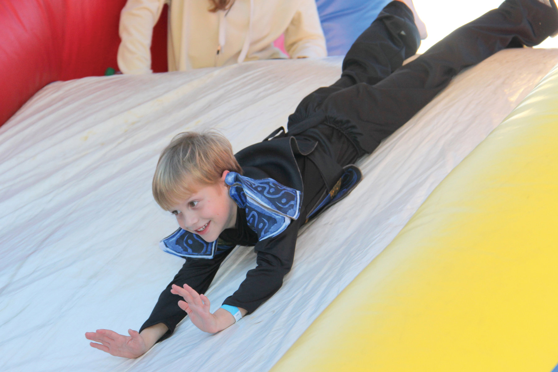 Kindergarten student William Hyatt enjoys the inflatable slide.