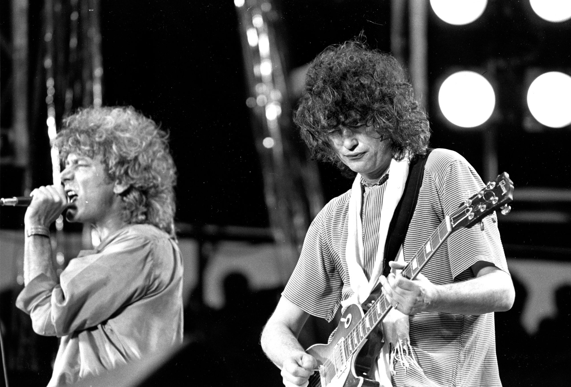 AP FILE PHOTO  Guitarist Jimmy Page of the British rock band Led Zeppelin performs July 13, 1985, at the Live Aid concert at Philadelphia's J.F.K. Stadium.