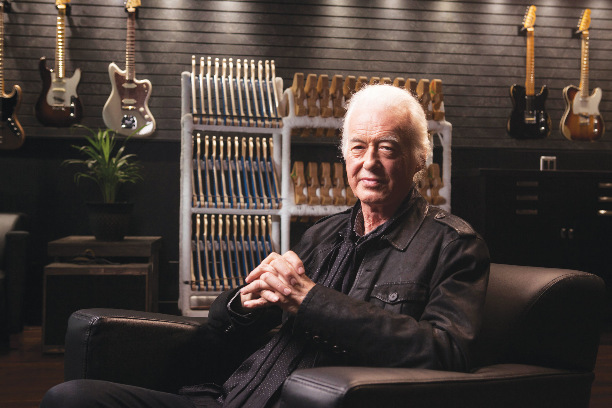 Photo by Rebecca Cabage / Invision/AP   Jimmy Page poses for a portrait at the Fender Factory in Corona, California. Page reflects on the wild year of 1968, when the Yardbirds crashed and Led Zeppelin was born.