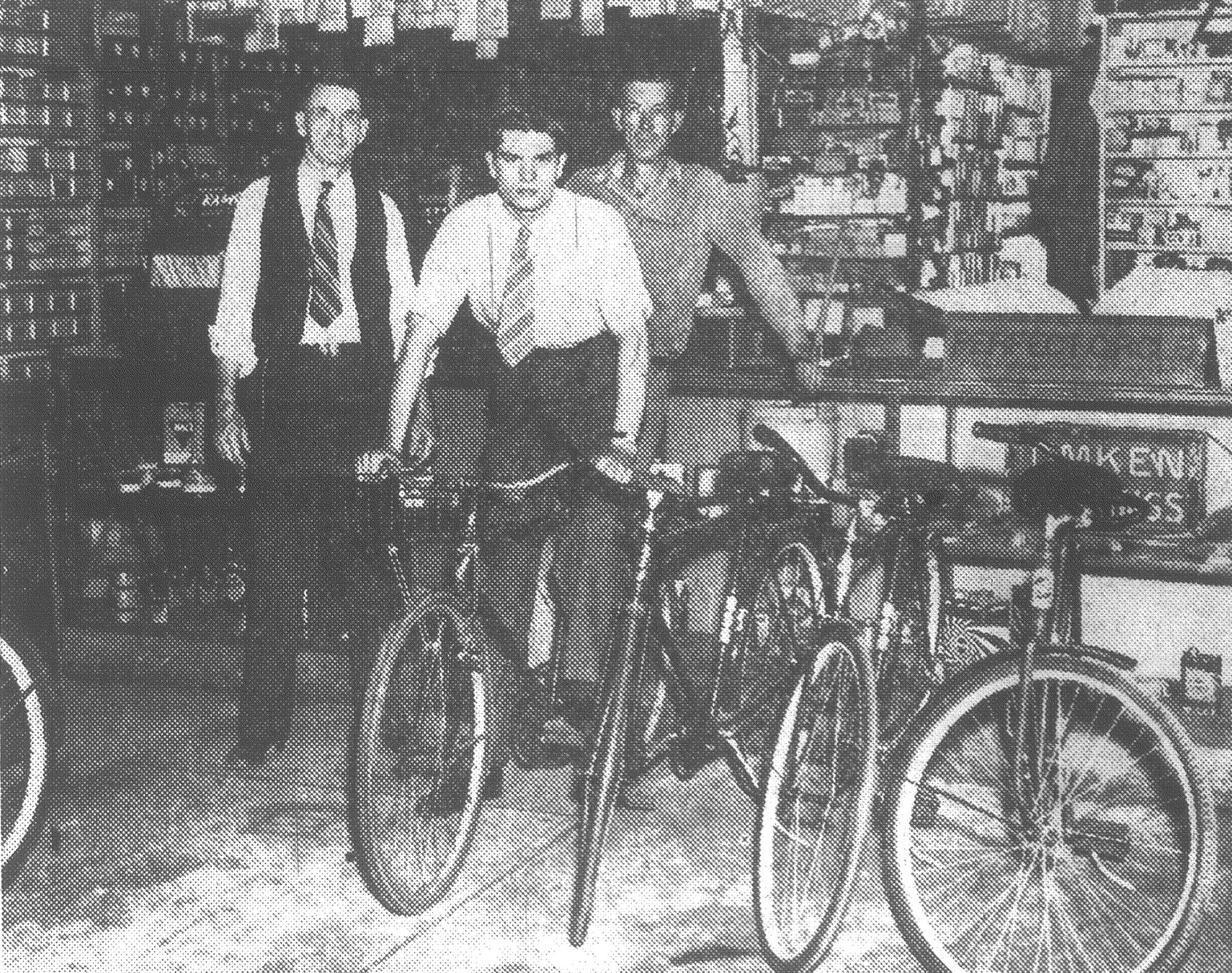 SUMTER ITEM FILE PHOTOs  Aubrey Hatfield is seen on his Victory bicycle he rode from Columbia to Sumter in three hours in 1943. At the left is his father, A. J. Hatfield, owner of the bicycle and automobile accessories business that bears his name, and at the right is Jim Shirer, bicycle repair man for A. J. Hatfield.