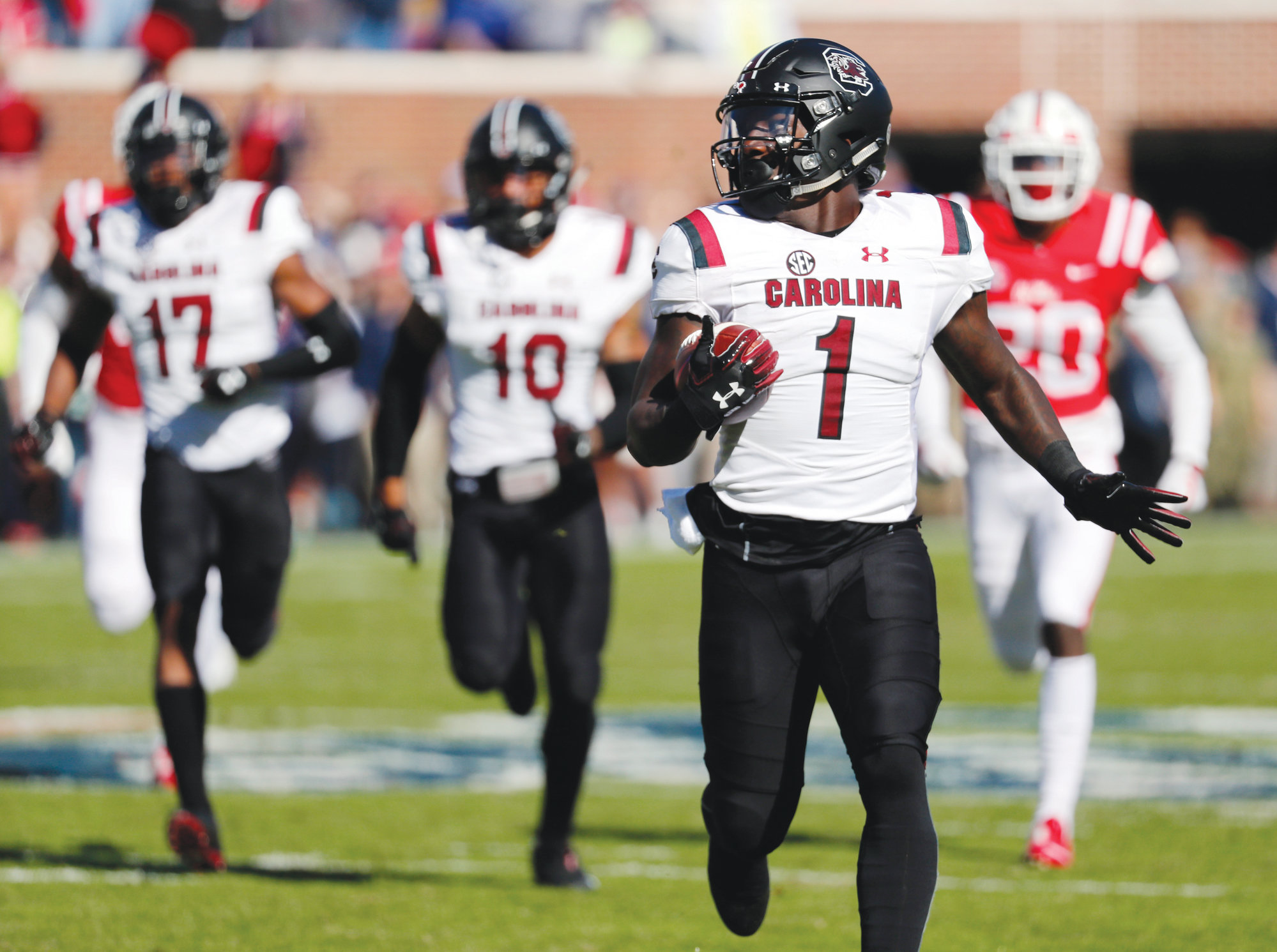 South Carolina's Deebo Samuel (1) looks around to make sure no Mississippi defender is near on his way to a 90-yard return for a touchdown nf the opening kickoff during the Gamecocks' 48-44 victory on Saturday in Oxford, Mississippi.