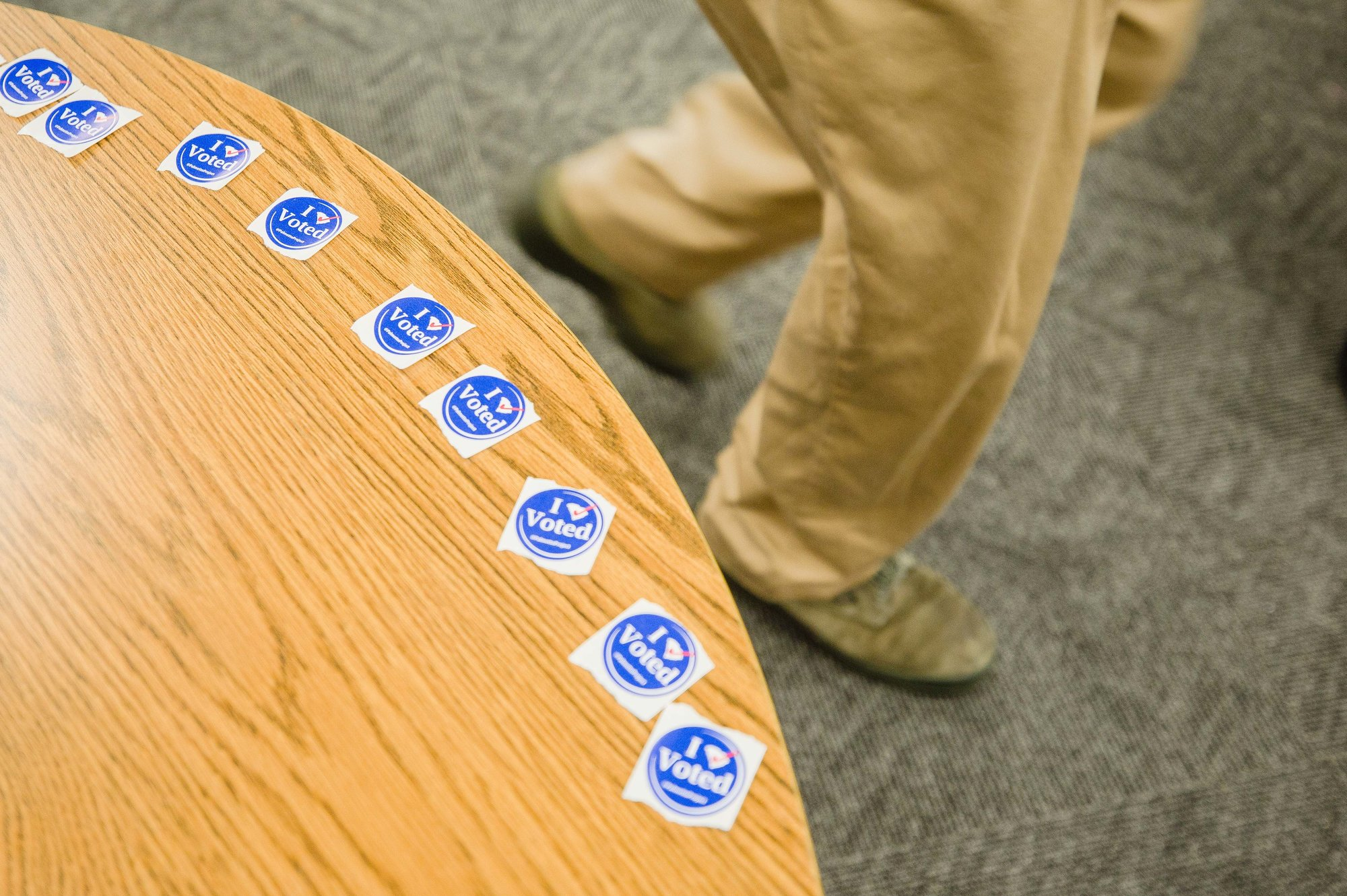"""I Voted"" stickers wait to takers on a table inside the Willow Drive Elementary School polling location Tuesday, Nov. 6."