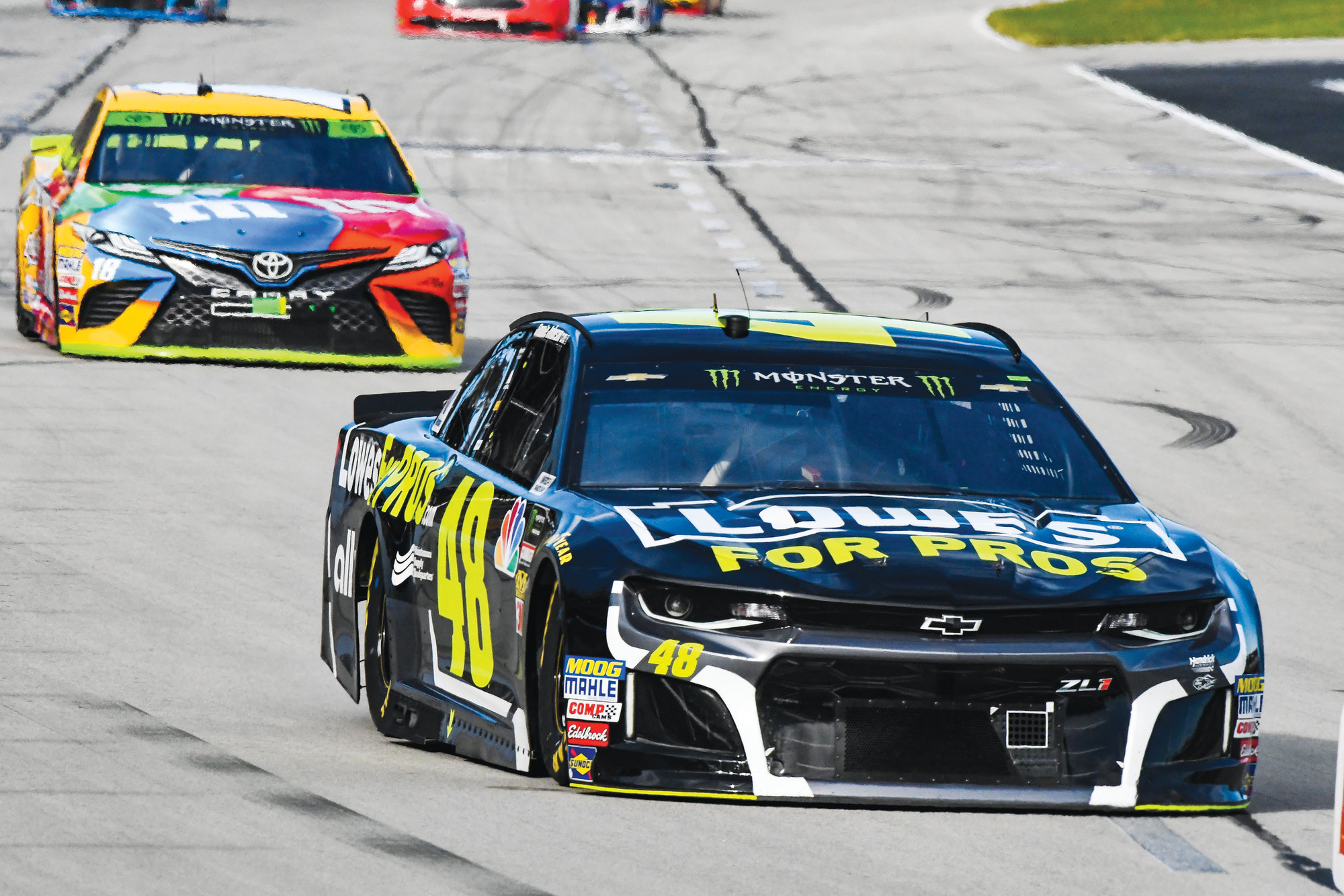 Jimmie Johnson (48) leads  Kyle Busch (18)  into Turn 1 during the AAA Texas 500 at  Texas Motor  Speedway on Sunday in Fort Worth, Texas. Johnson was wrongly sent to the back of the field prior to the start of the race.