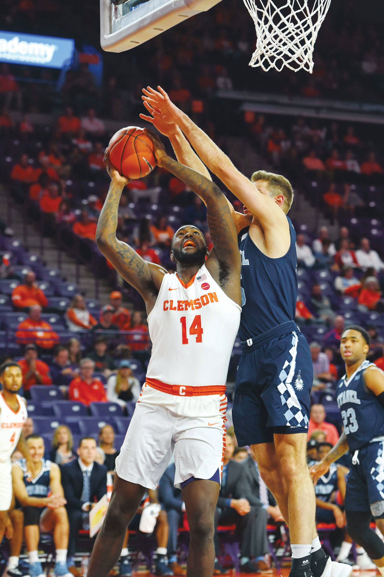 Clemson's Elijah Thomas drives to the basket while being defended by The Citadel's Zane Najdawl during the Tigers' 100-80 victory in the season-opening game for both teams on Tuesday in Clemson.