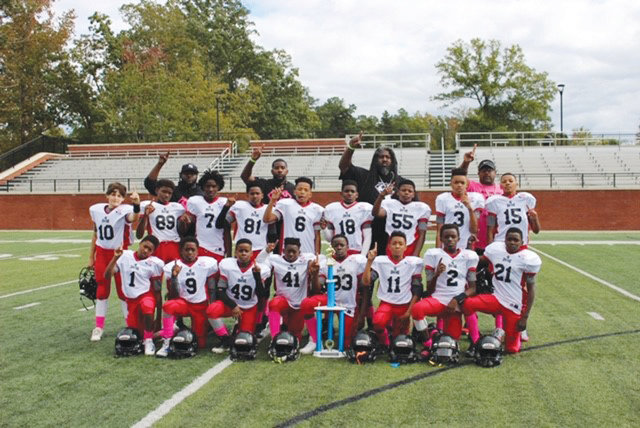 The YAS Spartans Pee Wee Pop Warner football team will be playing on Saturday at Donald L. Crolley Memorial Stadium in Dalzell with a chance to advance to the Mid-South Region Championship game in Virginia Beach, Virginia, on Nov. 24. Members of the team are, first row, left to right: Jaron Crittenden, Shondale Howard, Treyvian Lane, Troyreon Willis, Amaury Baker, Akelle Crawford, Jerron Pack and Jeremie Richardson. Second row: Thomas Moates, Damien Dingle, Kameron Fortune, Raymaynard Tate, Kyle Mitchell, Maliek Billups, Jayden Kennedy, Khalil Moody and Jahiem Jones. Third row: Assistant coach Travalle Jenkins, assistant coach Raymaynard Tate, assistant coach Dwayne Crim and president/head coach Ivan Sanders.