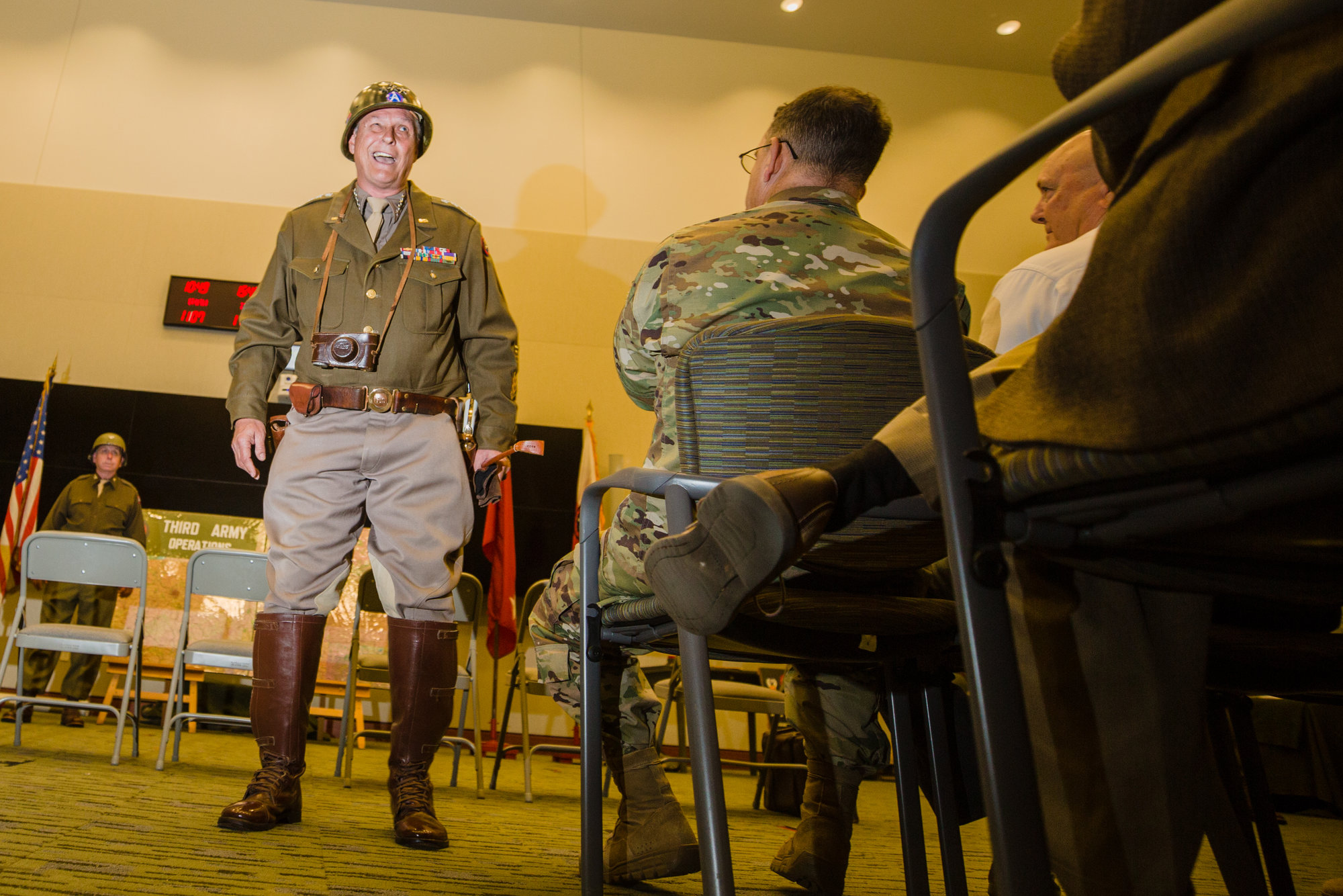 Gen. Patton, portrayed by Denny G. Hair, speaks with attendees at the celebration of Third Army's 100th birthday.