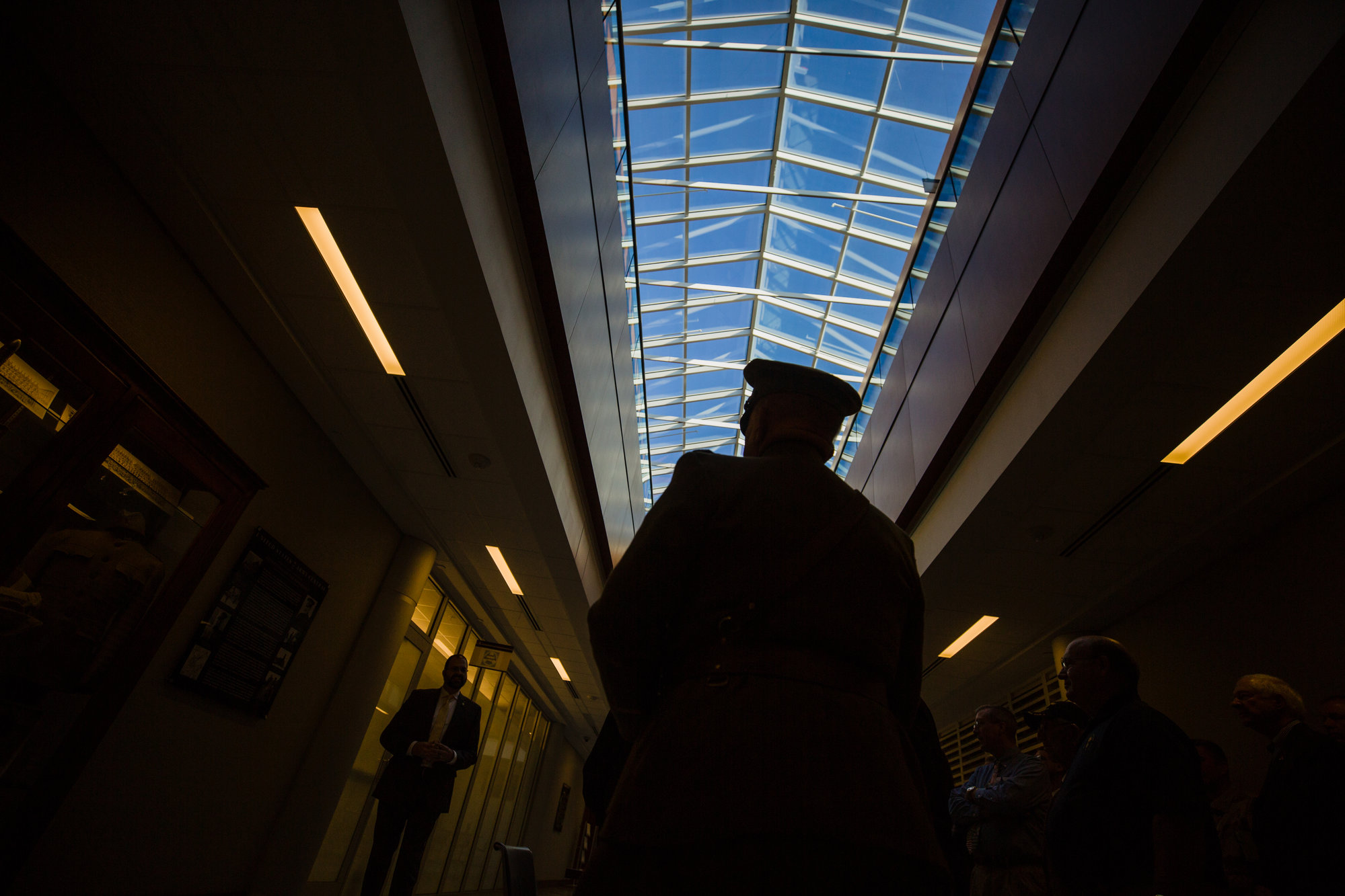 A living history re-enactor is silhouetted in the skylight in the main hall at ARCENT.