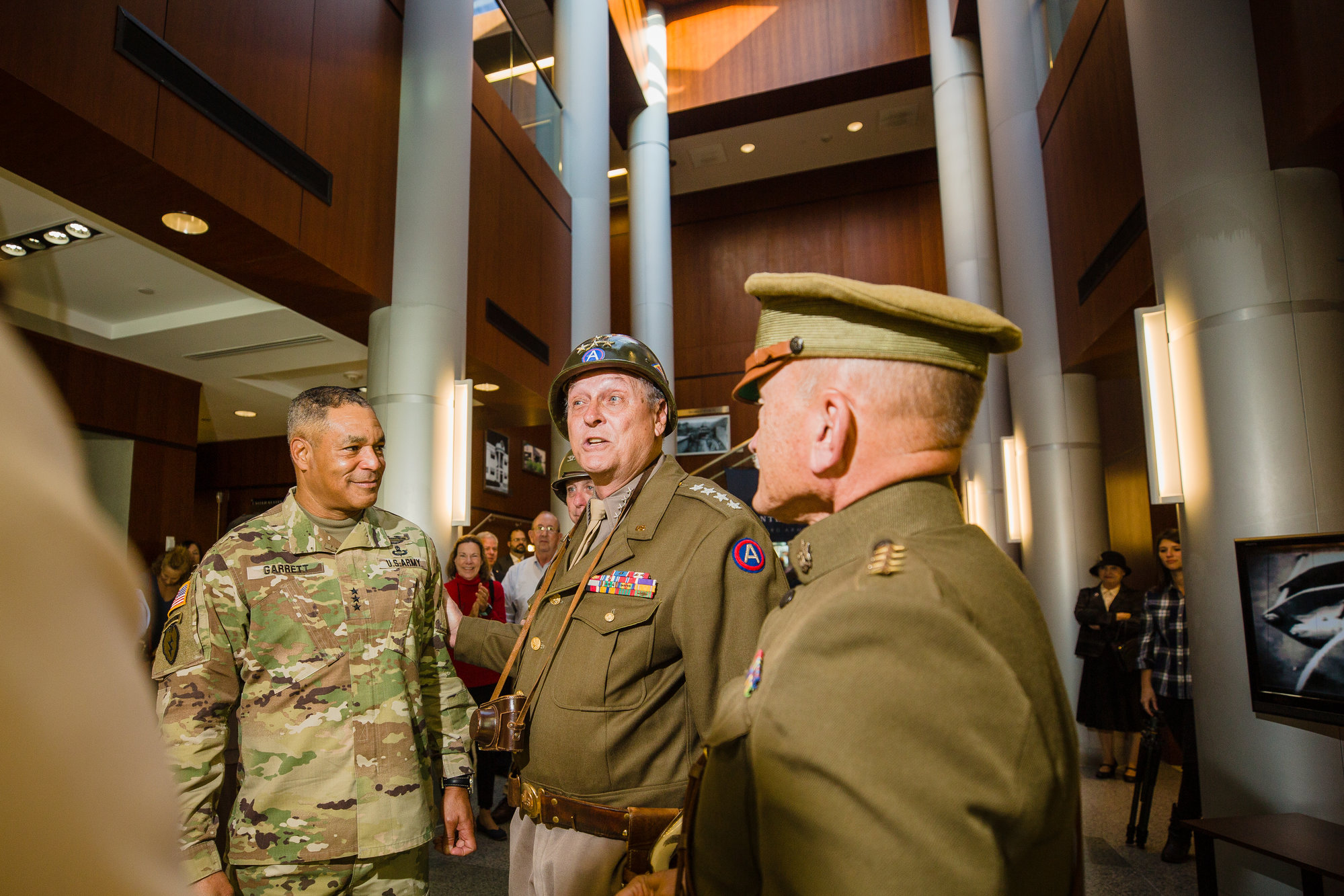 Lt. Gen. Michael X. Garrett, U.S. Army Central commanding general, laughs with Gen. George S. Patton Jr., portrayed by living historian Denny G. Hair, before touring ARCENT's Headquarters at Shaw Air Force Base on Wednesday in celebration of Third Army's 100th birthday.
