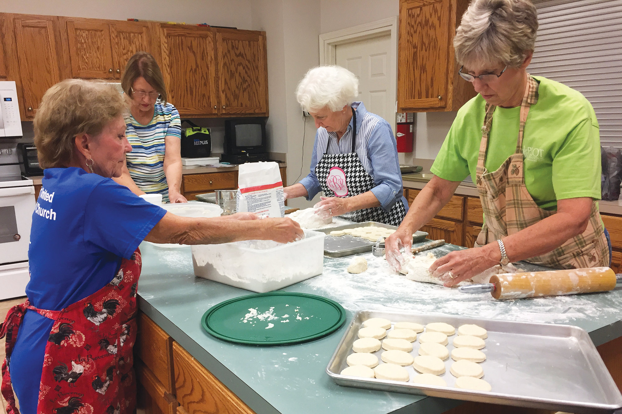 PHOTO PROVIDEDMembers of the Clarendon Pilot Club have been busily baking 184 dozen homemade biscuits for their club's annual bazaar that will be held from 4 to 6 p.m. Saturday, Nov. 20, at Manning Presbyterian Church, 233 N. Brooks St. From left, club members Camille Daniel, Gloria Watts, Carolyn Brewer and Peggy Benton are shown elbows deep in flour and butter making and baking the biscuits that are the highlight of each year's bazaar.