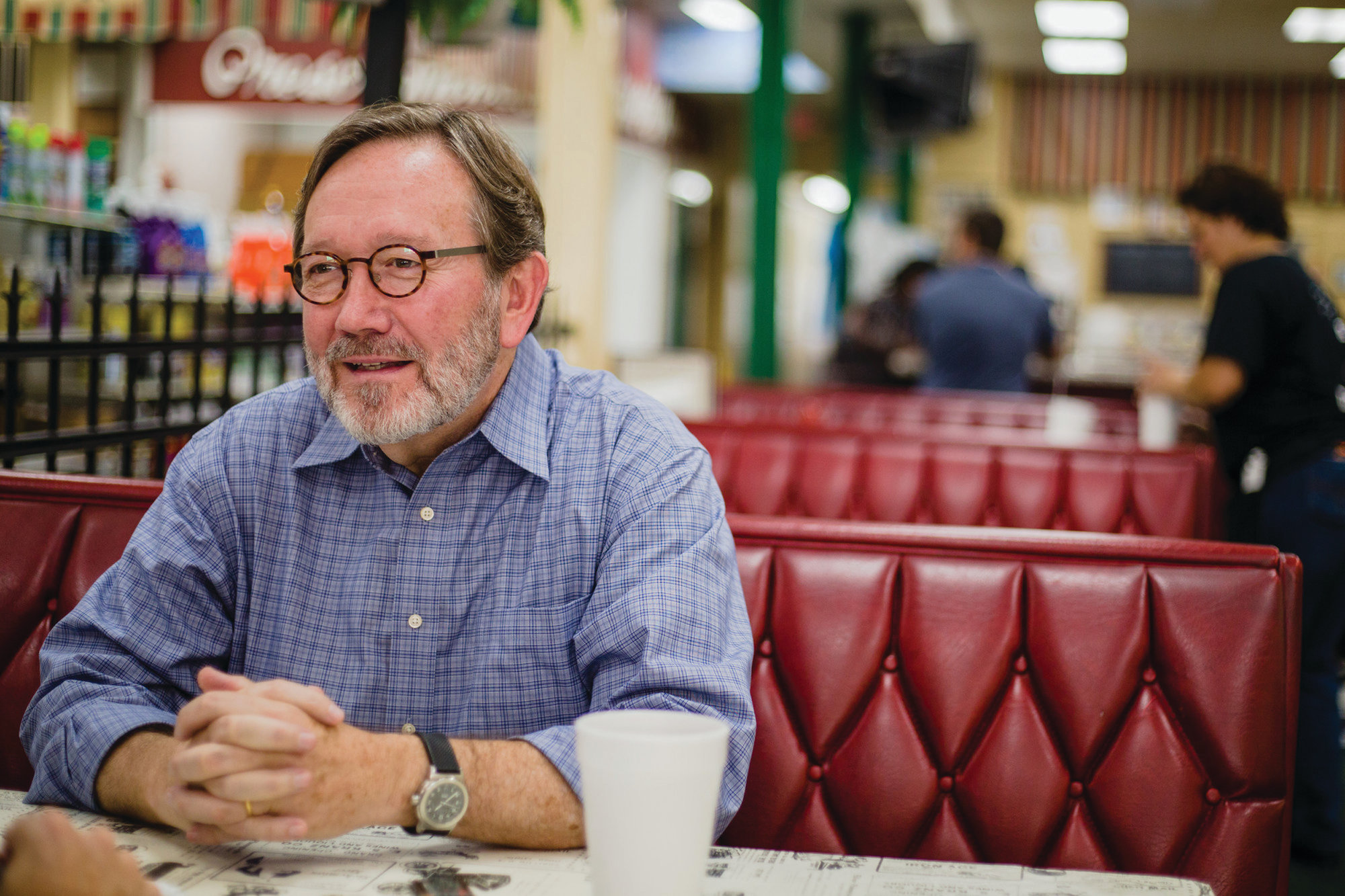 In this file photo, Archie Parnell sits at Sumter Cut Rate Soda Fountain and Drug Store ahead of the 2018 election for South Carolina's 5th congressional district, a seat that was retained by U.S. Rep. Ralph Norman.