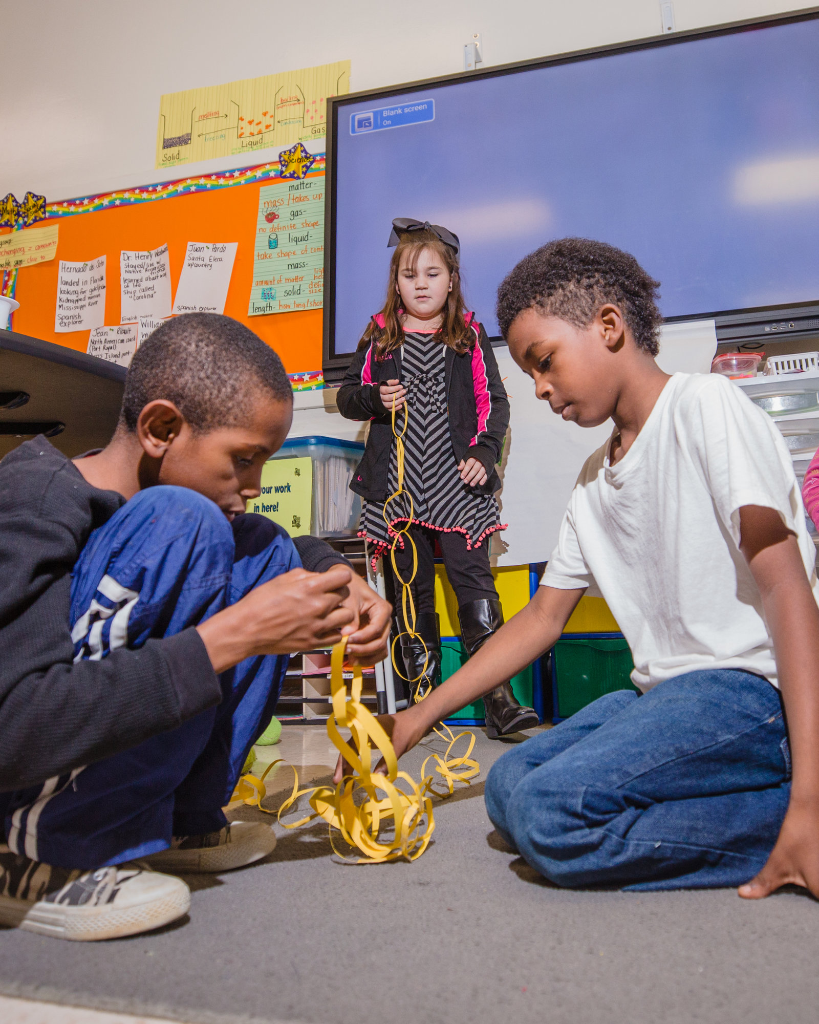 Larry McLeod, Lesley JAmison and Ty'won Jones work on their chain in Tiffany Marshall's third grade class.