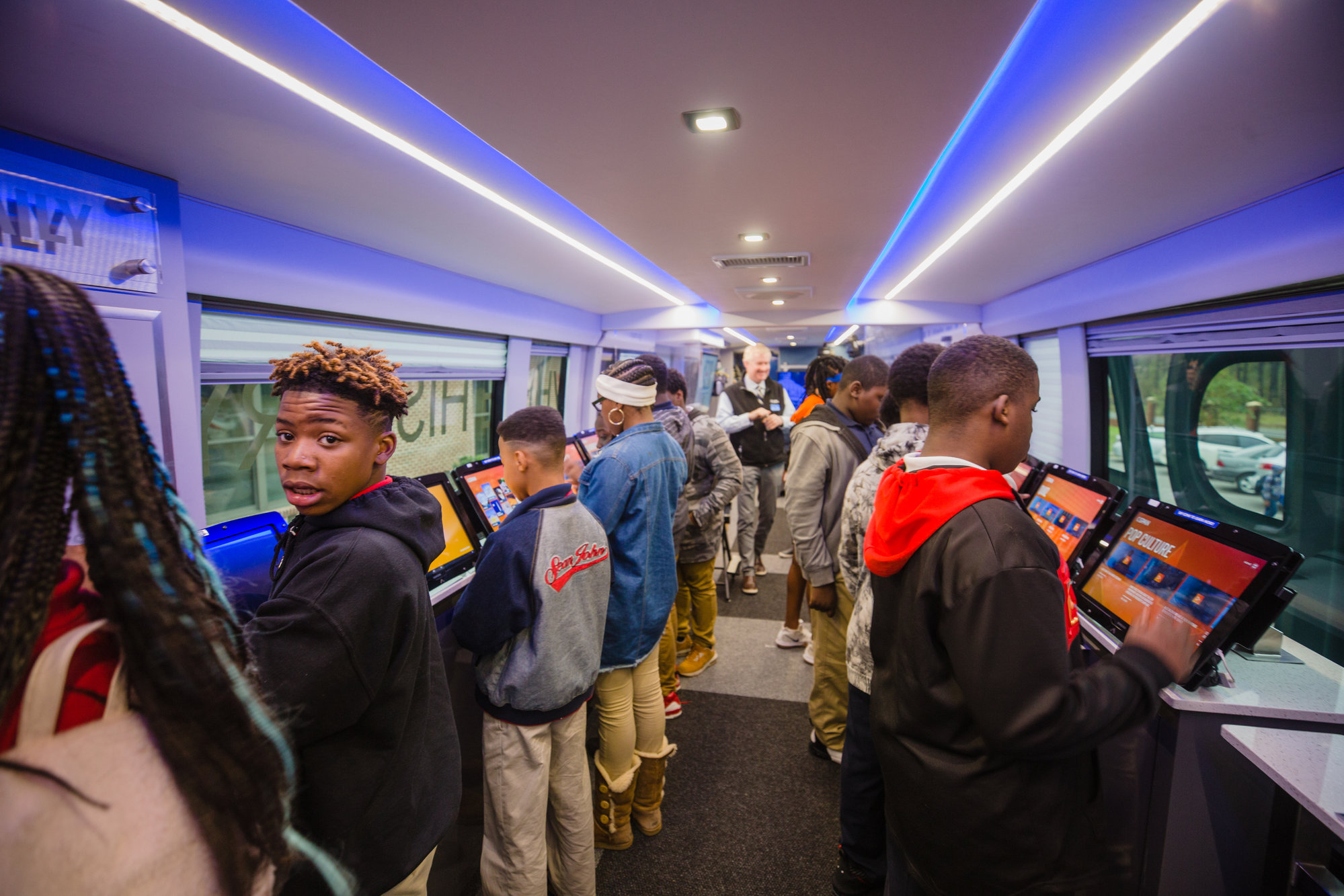 Eighth-graders from R.E. Davis College Preparatory Academy check out touch screens filled with quizzes, videos and other educational information on board the C-SPAN bus on Tuesday. The bus is visiting schools across the country.
