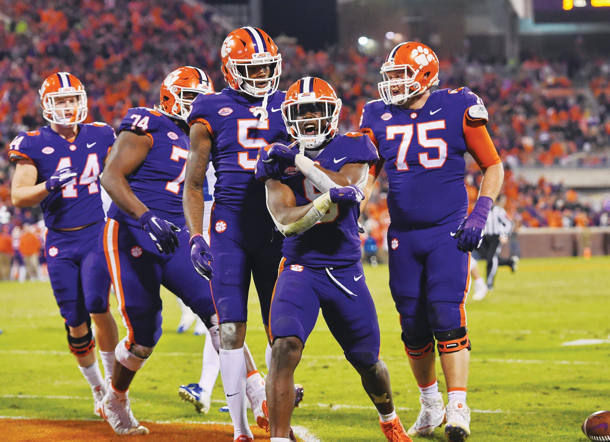Clemson's Travis Etienne, front, celebrates an insurance touchdown with teammates during the second half of the Tigers' 21-13 victory over Duke last week in Clemson. Clemson hosts South Carolina on Saturday in the 116th meeting between the two schools.