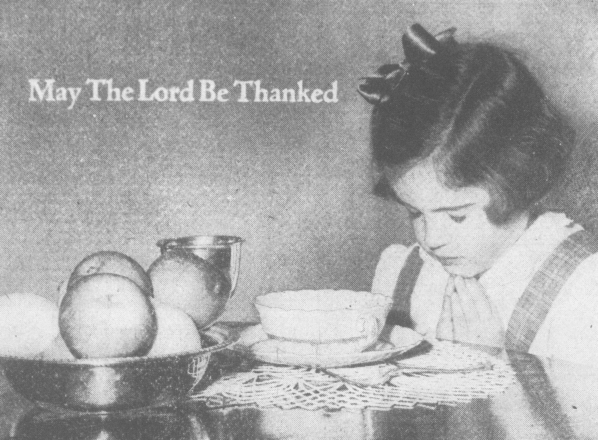 A Sumter girl gives her thanks during a Thanksgiving meal in 1951.