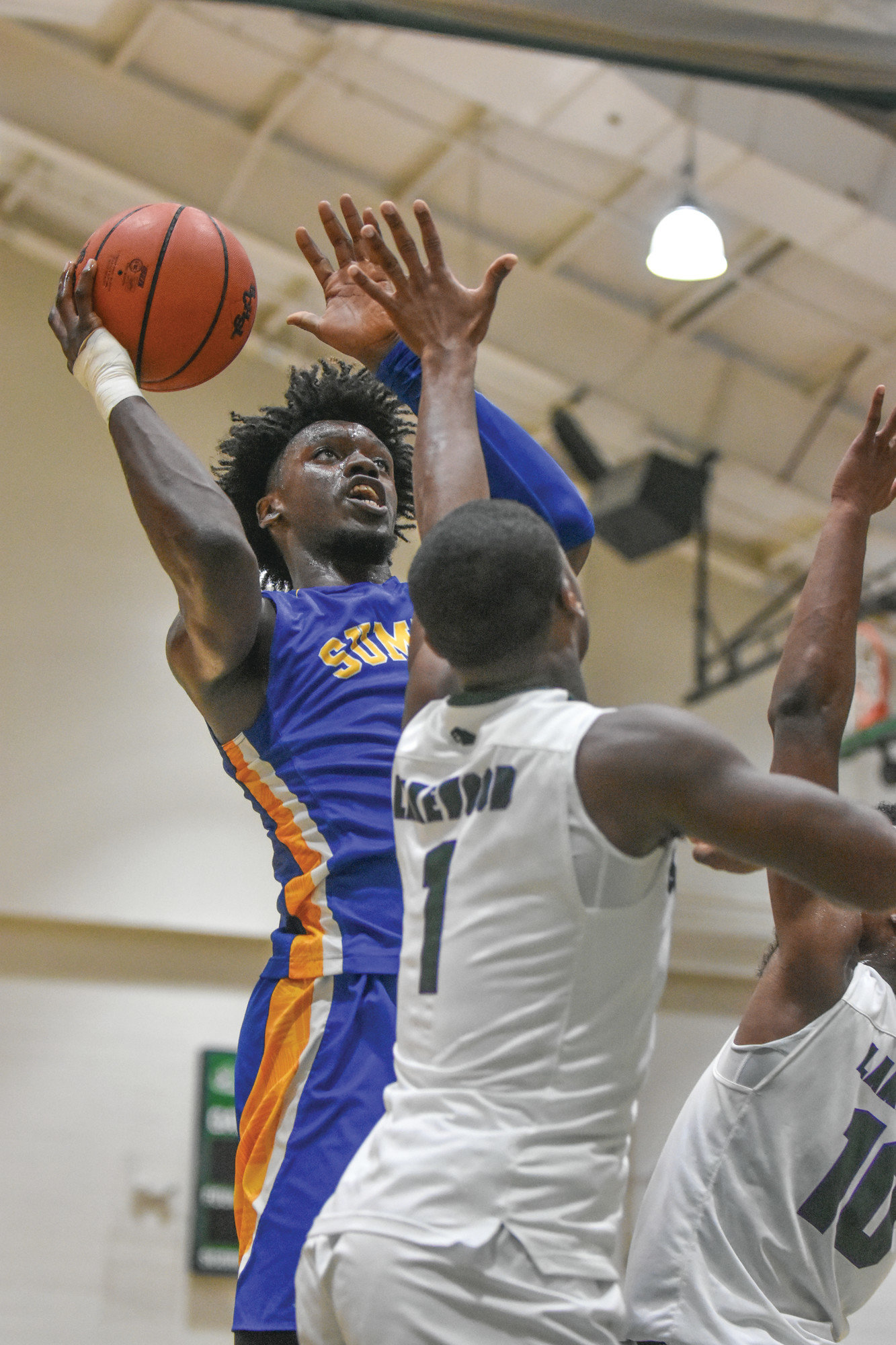 Trevor Bauknight / The Sumter ItemSumter High School's Calvin Felder, left, goes up for a shot in the Gamecocks' 69-61 loss to Lakewood on Friday. Sumter plays host to Hartsville and South Carolina commitment Trae Hannibal on Tuesday.