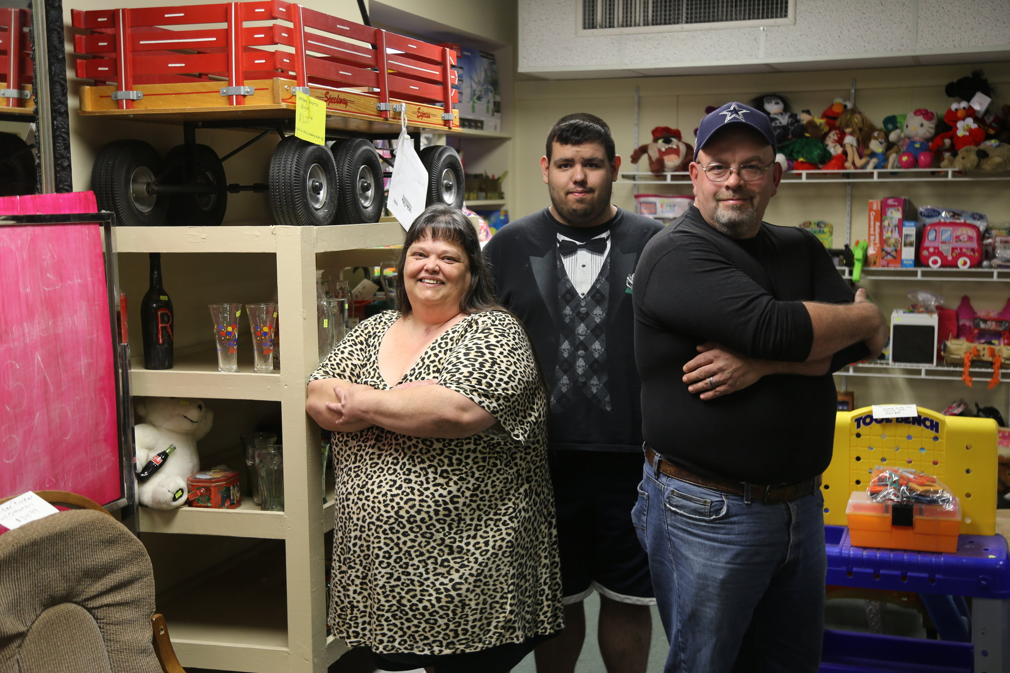 BRUCE MILLS  /  THE SUMTER ITEMThe Lloyd family, from left, Stacey, Shane and Rodney, stand in their family thrift store on Liberty Street on Tuesday.