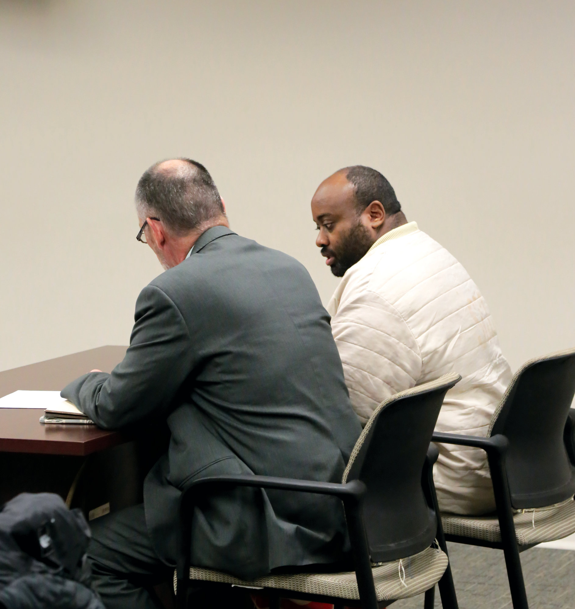 Demetrius Brown sits with his public defender, Tim Murphy, during Brown's hearing on Thursday morning.