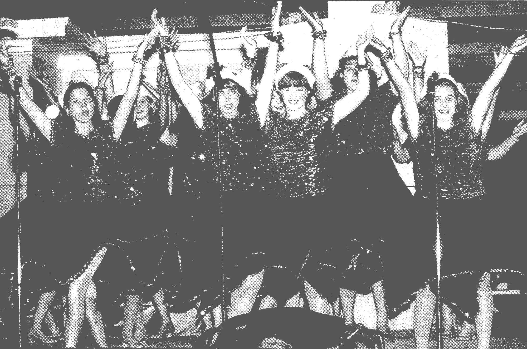 1993 - Students from Sumter High School perform as a show choir in the Pilot Club's 14th-annual lighting of the Swan Lake Christmas tree. The tree lighting attracted a sizable crowd to hear Christmas songs and see the lights.