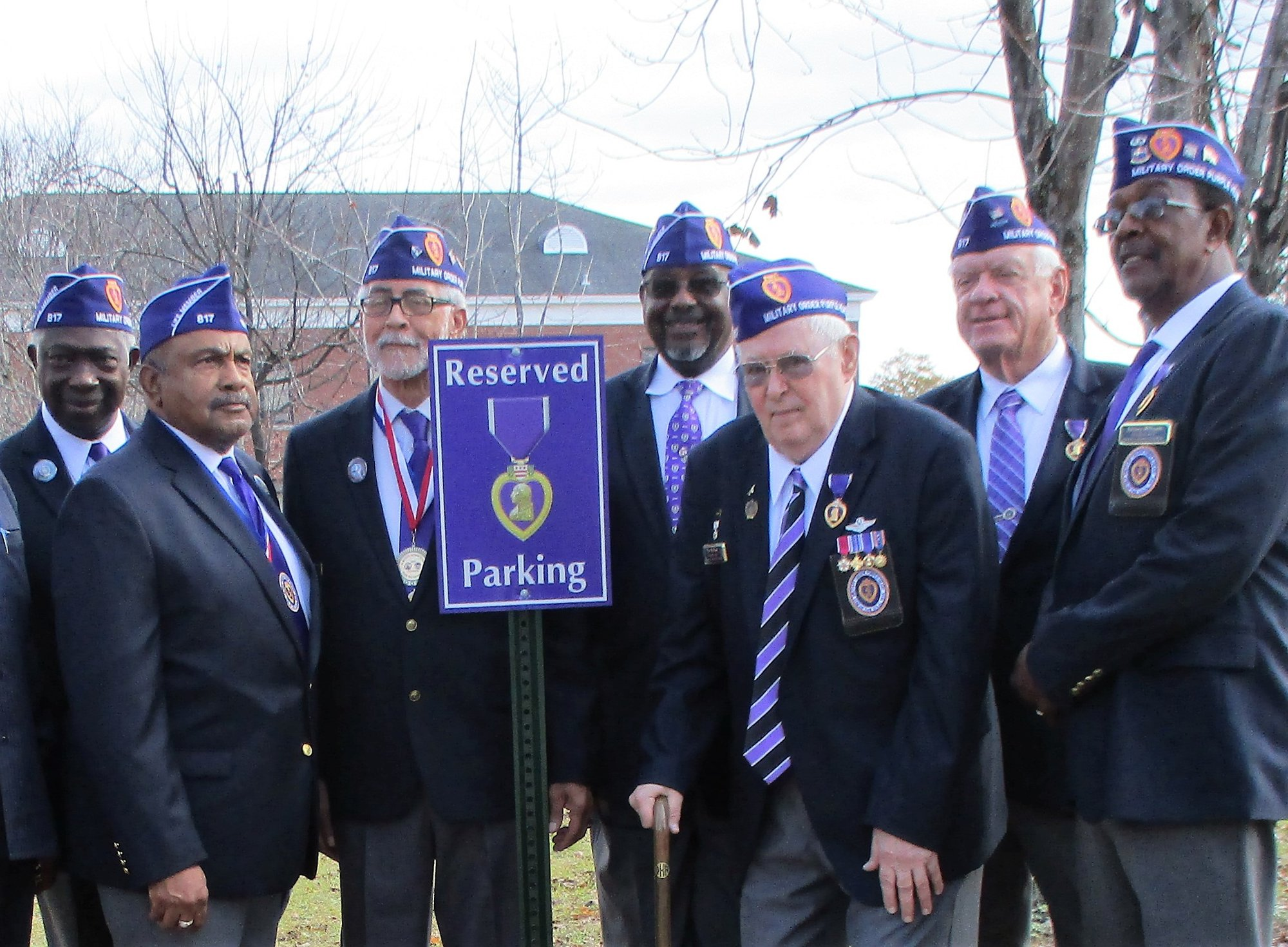 PHOTO PROVIDEDFrom left at the Purple Heart Reserved Parking Place at Morris College are Sumter Purple Heart Chapter 817 Patriot Jessie Burgess, Commander Harry Thompson, Patriot Ron Harvin, Adjutant Leroy Thompson and Patriots Don Kellum, Dave Nesbitt, and Johnny Williams.