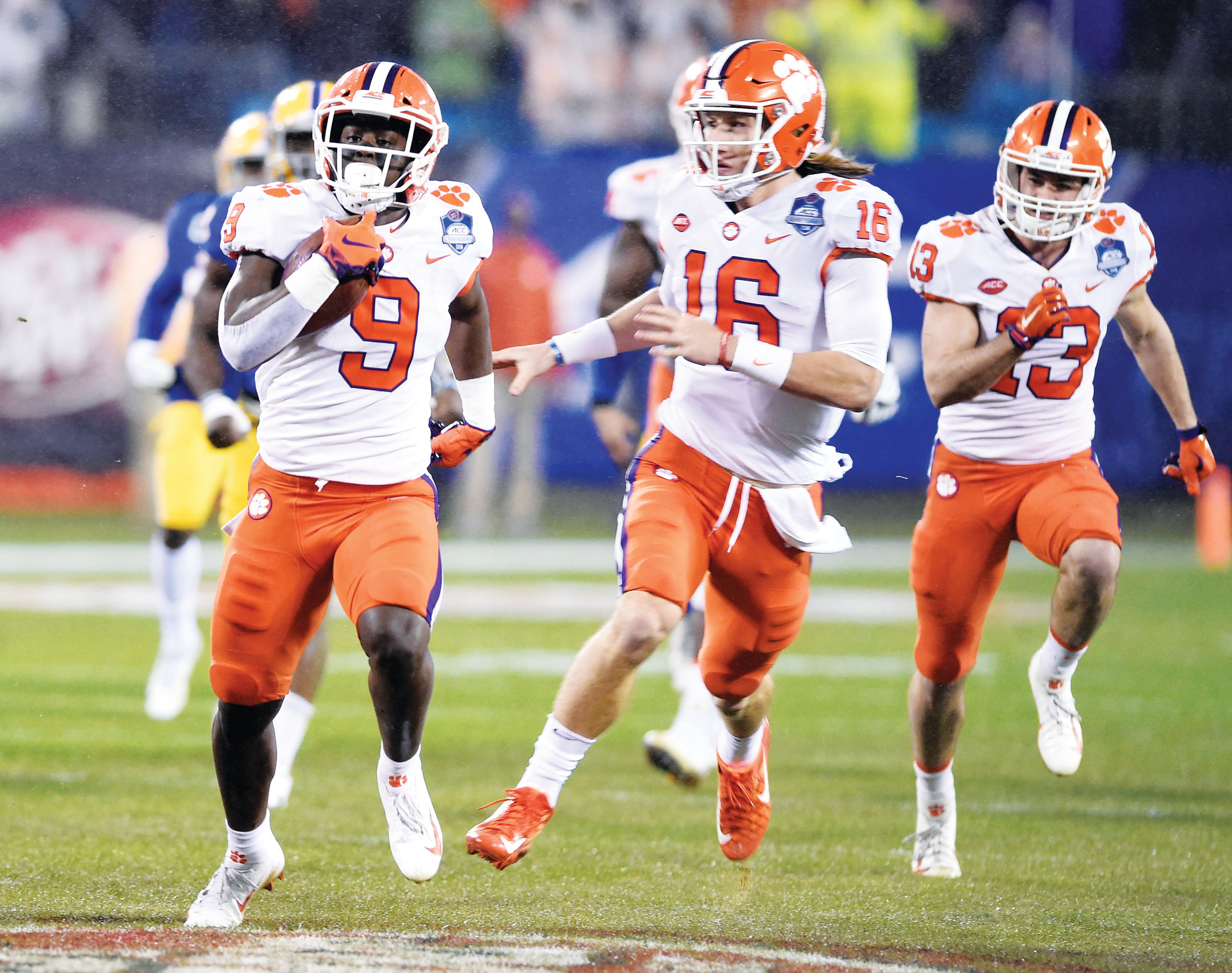 Clemson's Travis Etienne (9) followed by quarterback Trevor Lawrence (16) runs for a touchdown against Pittsburgh in the first half of the Atlantic Coast Conference championship game Charlotte last weekend. Etienne and Lawrence lead Clemson's high-octane offense.