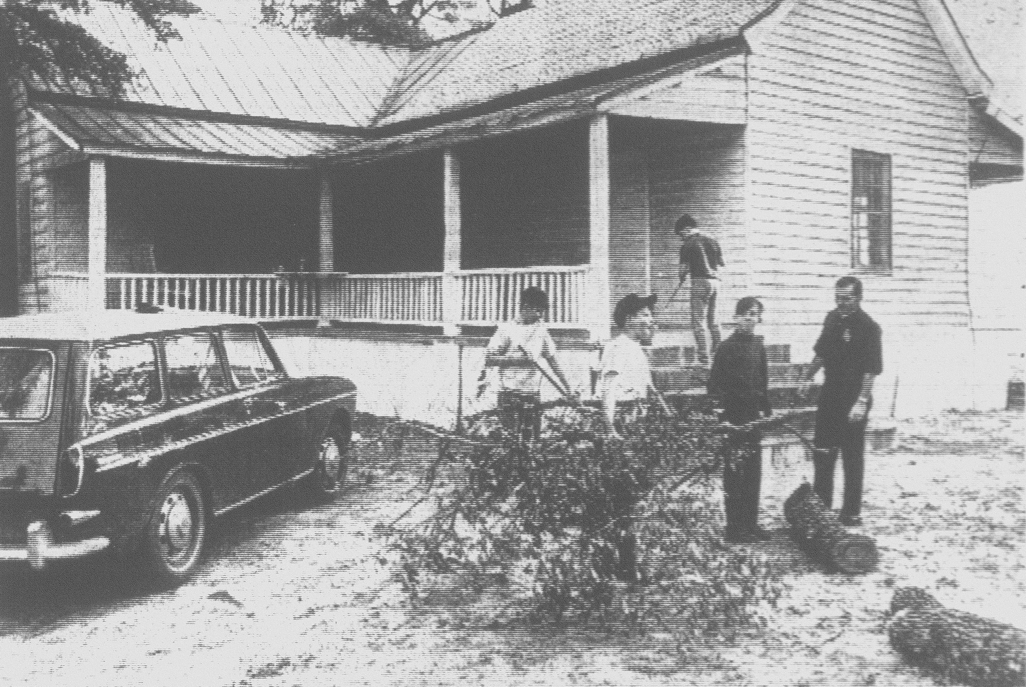 1968 - This six-room house with three porches was converted from a family home to a coffeehouse for youth in the Mayewood School area. Rev. B. A. Wesley, far right, and some of the boys finish clearing the yard. Teenagers from the community worked on the house for two weeks getting it ready for their opening night. Three of the rooms were to be used as game rooms, two for music and one for food.