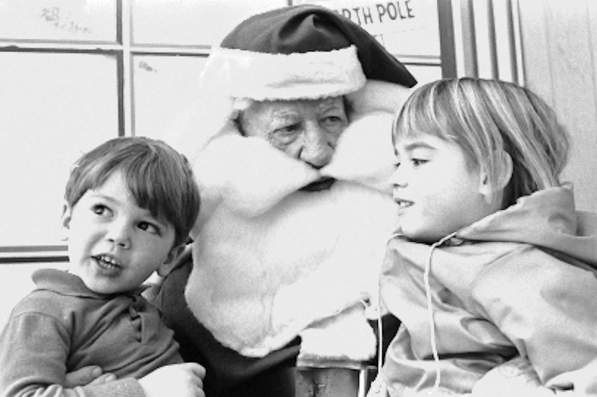 Children greet Santa at Woolco in Sumter in 1969.