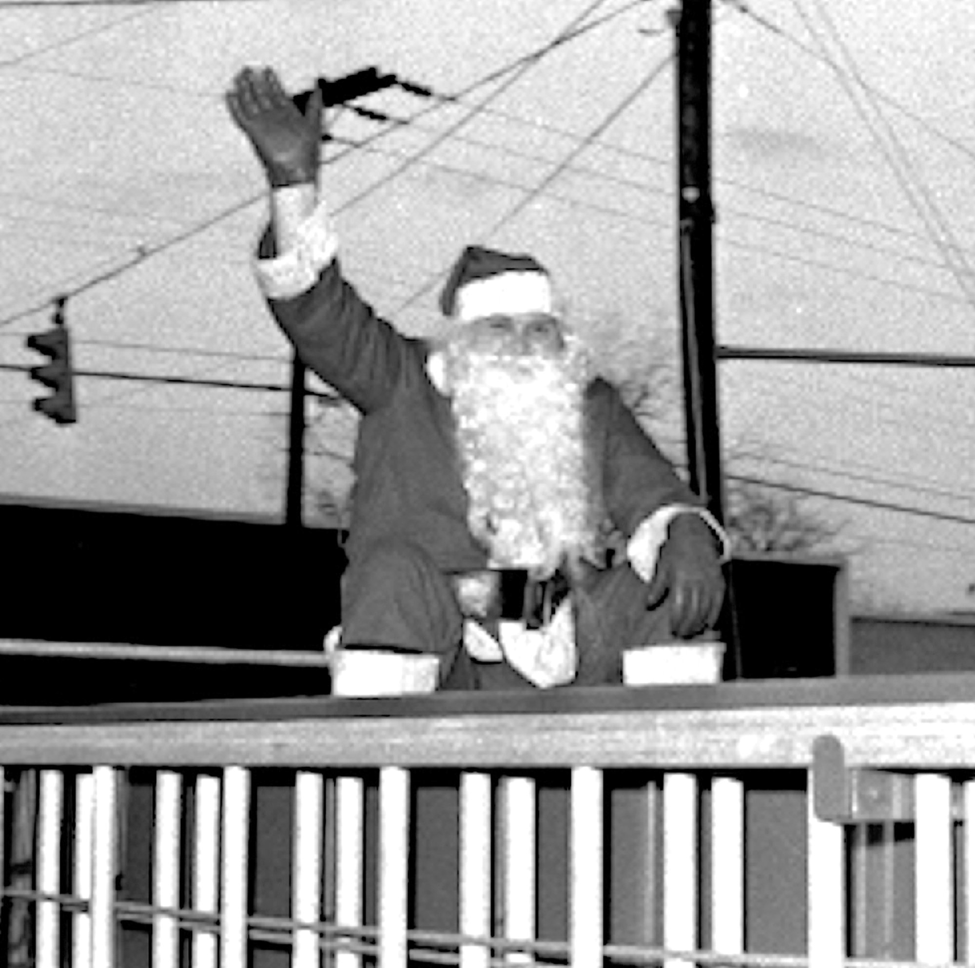 Santa rides in the 1969 Sumter Christmas Parade on a fire truck.