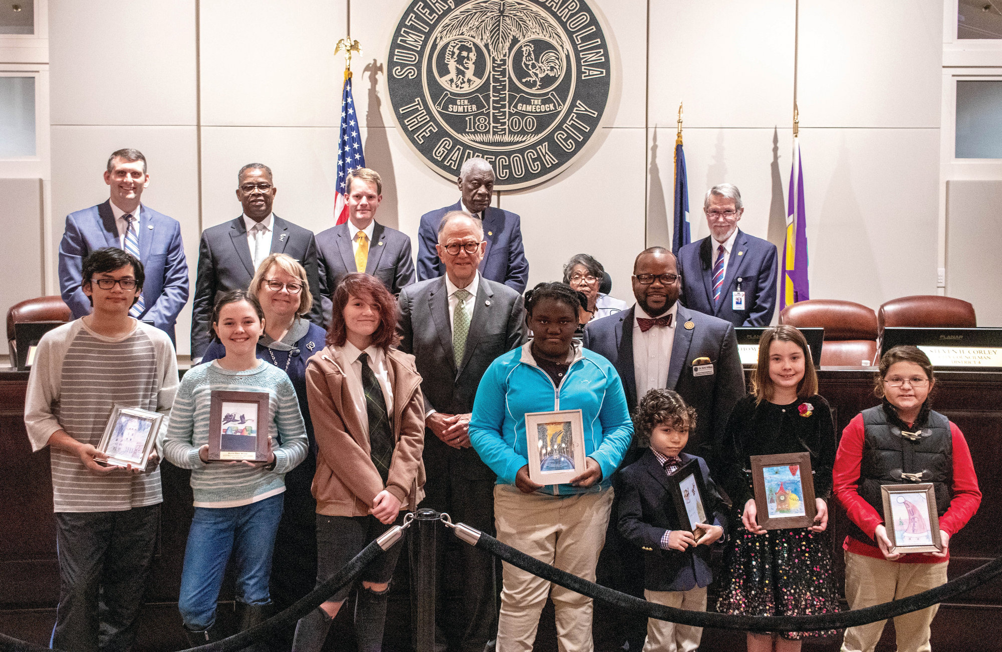PHOTOS PROVIDEDPhotographed are several of the winners in the City of Sumter Mayor's Christmas Card Contest, Aiden Tolson, Abbigail Grossman, Brianna Riley, Ebony Osborne, McKayla Mouradjian, Murrin Reed, Benjamin Morrow and Kali Katz; Sumter School District Interim Superintendent Debbie Hamm; Mayor Joe McElveen; Assistant Superintendent for Leadership and School Excellence Norris Williams; councilman Steve Corley; councilman Ione Dwyer; councilman Thomas Lowery; councilman Colin Davis;