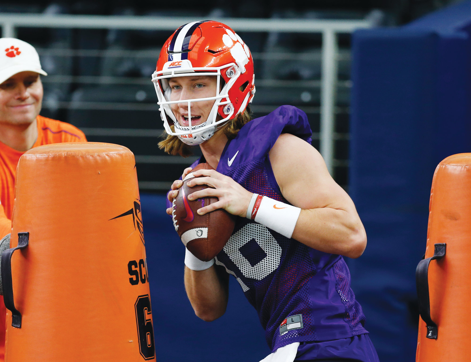 Clemson quarterback Trevor Lawrence (16) sets to pass during team practice at AT&T Stadium in Arlington, Texas, on Monday. Clemson is scheduled to play Notre Dame in the Cotton Bowl College Football Playoff semifinal on Saturday.