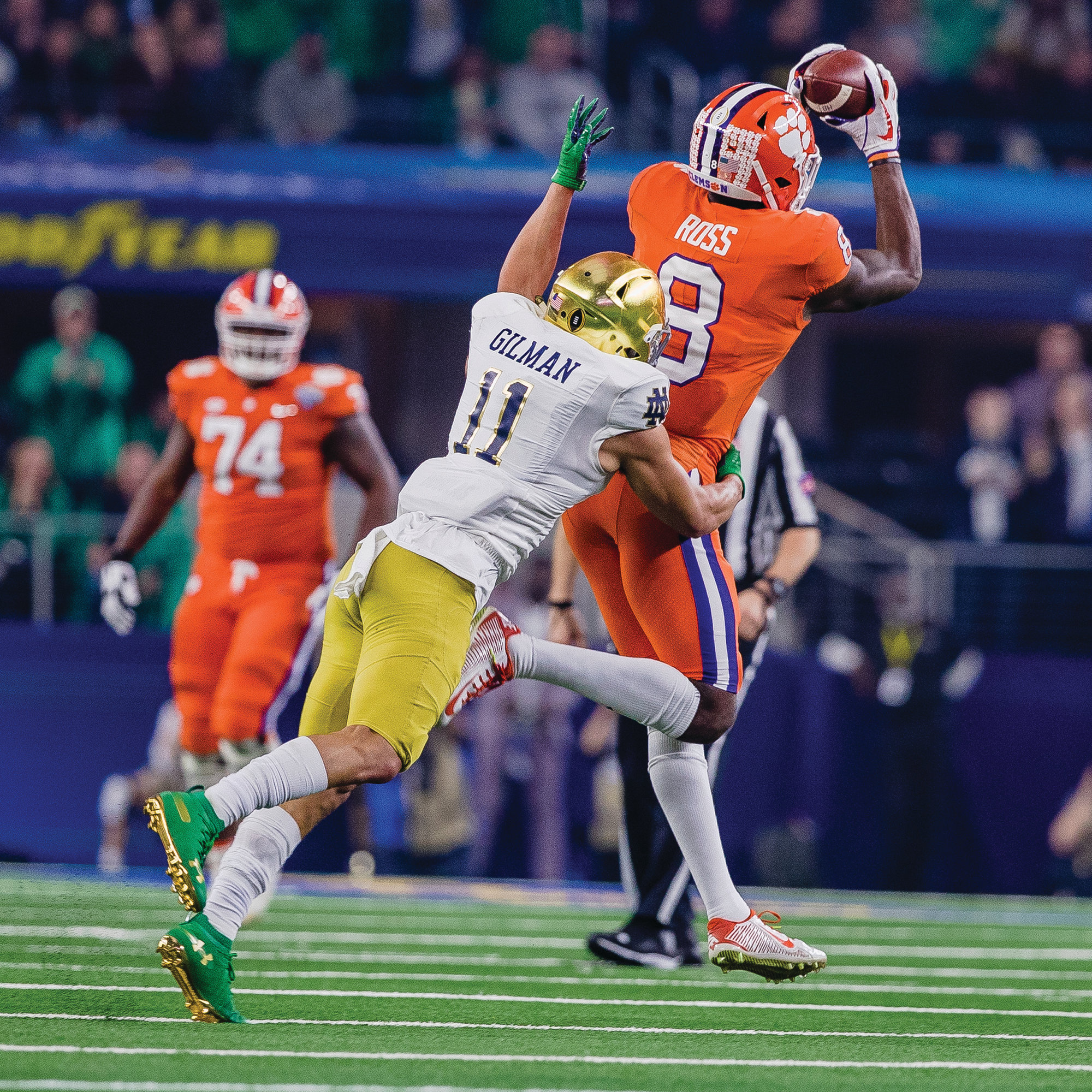 Clemson true freshman wide receiver Justyn Ross (8) catches a touchdown pass in front of Notre Dame safety Alohi Gilman during the Tigers' 30-3 victory in the Cotton Bowl.