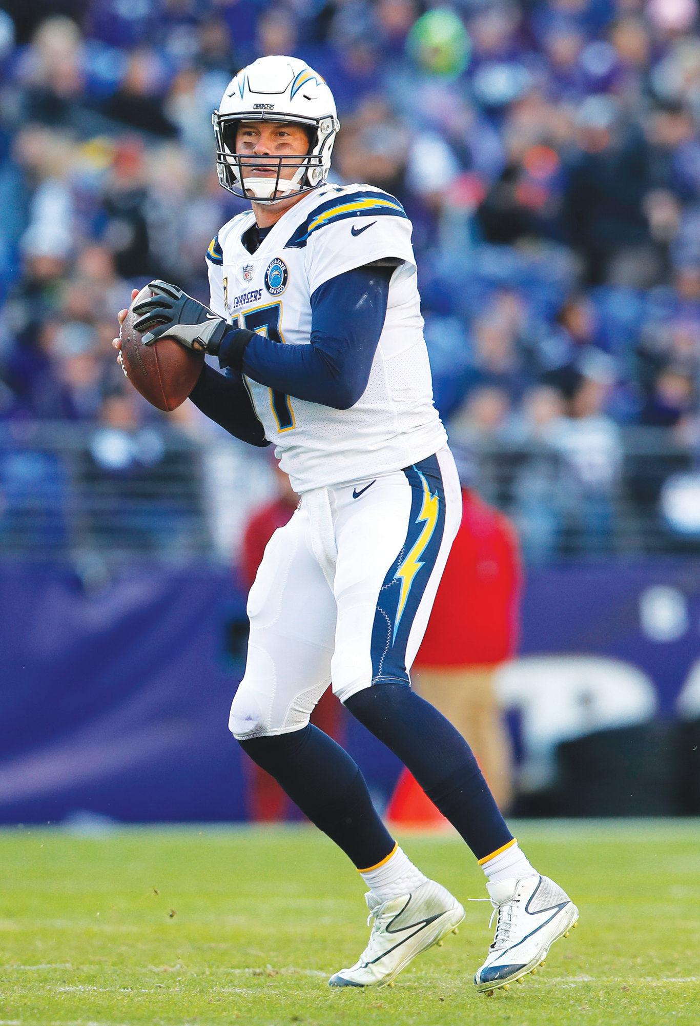 THE ASSOCIATED PRESS  Los Angeles Chargers quarterback Philip Rivers looks for a receiver in the NFL wild card playoff game against the Ravens on Sunday in Baltimore.