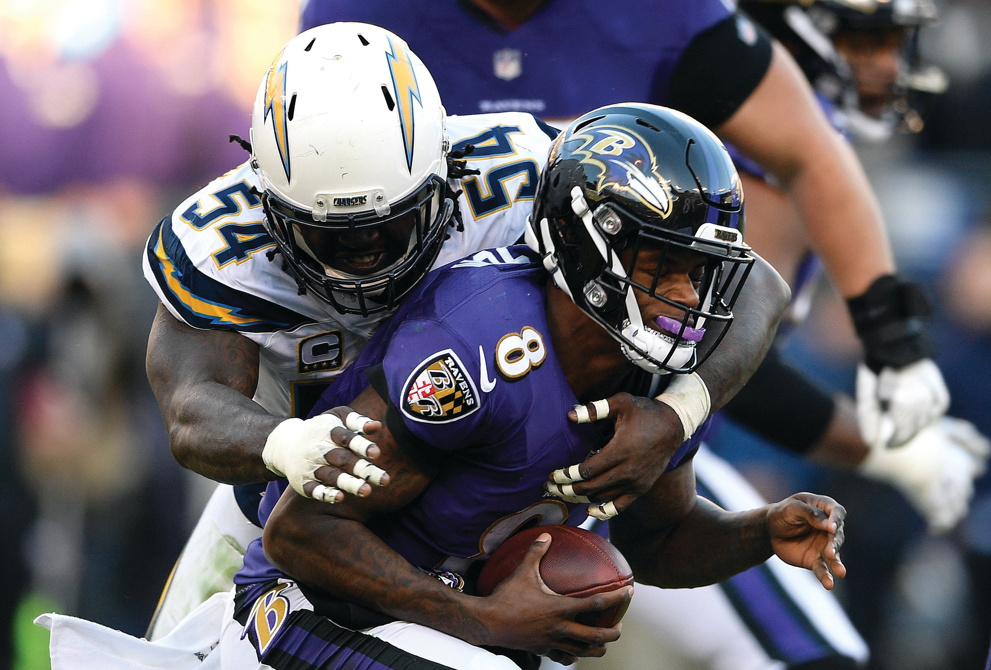 THE ASSOCIATED PRESS  Los Angeles Chargers defensive end Melvin Ingram (54) sacks Baltimore quarterback  Lamar Jackson in the Chargers' 23-17 win in the NFC wild-card game on Sunday in Baltimore.  =