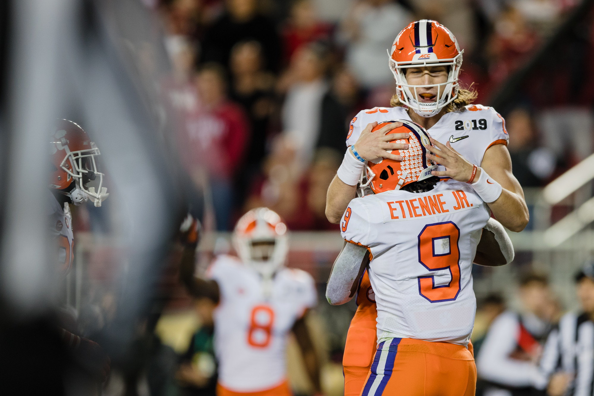 Clemson quarterback Trevor Lawrence celebrates with running back Travis Etienne in the first half of the CFP National Championship game at Levi's Stadium in Santa Clara, California.