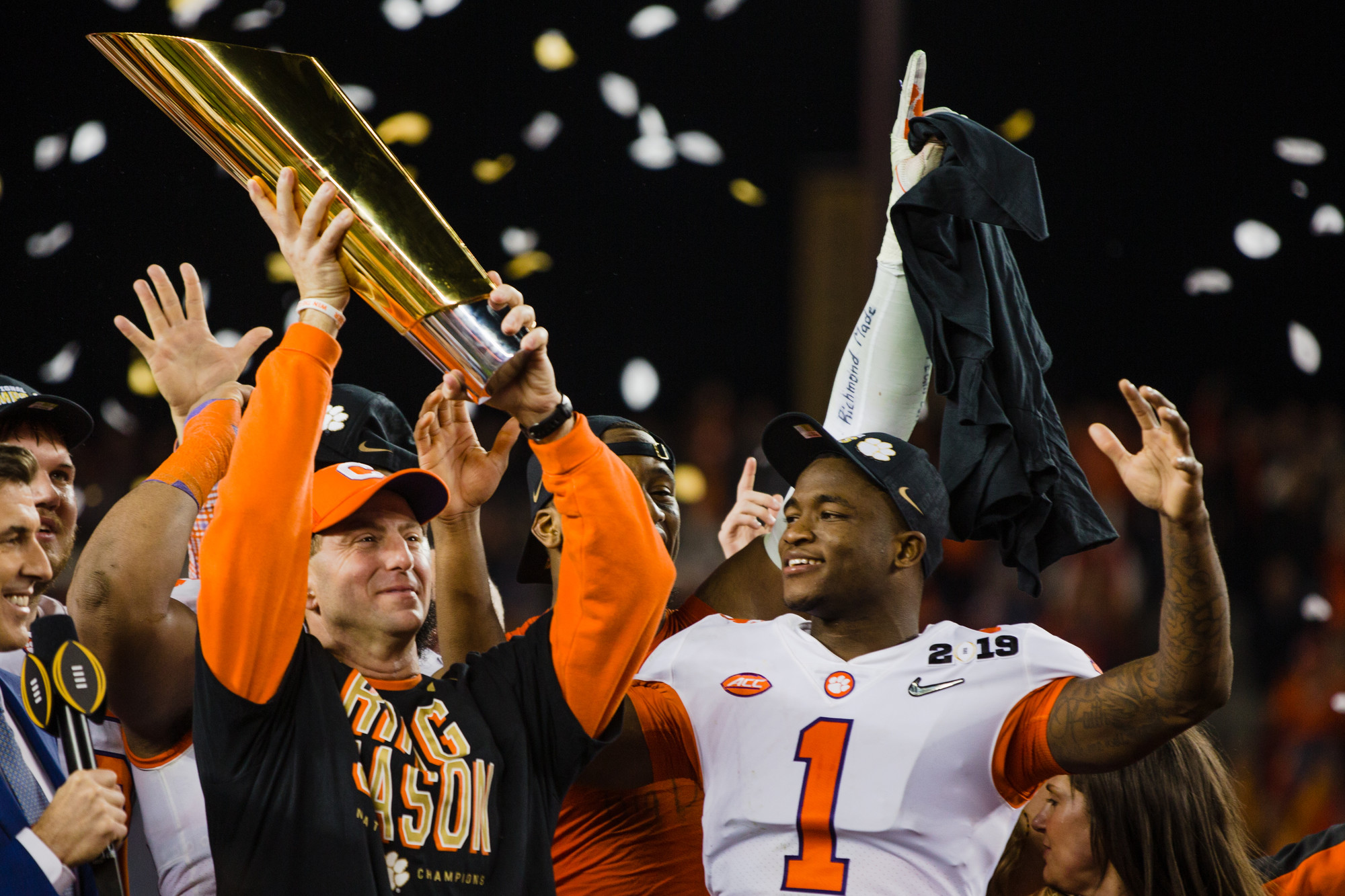 Clemson head coach Dabo Swinney hoists the trophy after the Tigers routed Alabama 44-16 to win the 2019 CFP National Championship game at Levi's Stadium in Santa Clara, California, on Monday, Jan. 7. To his left is cornerback Trayvon Mullen, the game's defensive MVP who finished with an interception and a sack.
