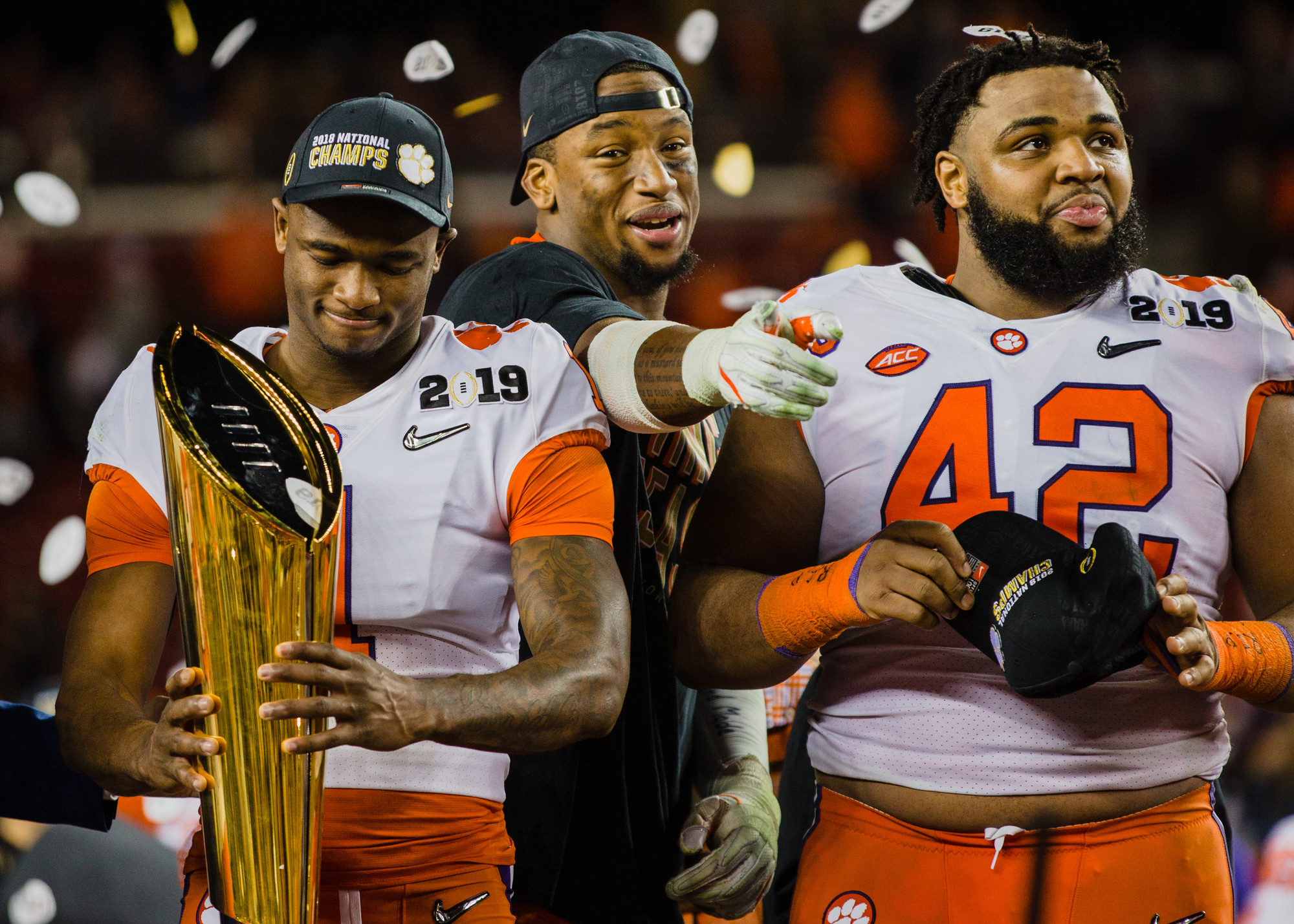 Clemson defensive tackle Christian Wilkins, right, takes in the moment after the Tigers routed Alabama to win the 2019 CFP National Championship at Levi's Stadium in Santa Clara, California, on Monday, Jan. 7. Wilkins and the rest of the senior class went 55-4 in their time at Clemson, winning two national championship, both against the Crimson Tide, and four ACC conference titles.