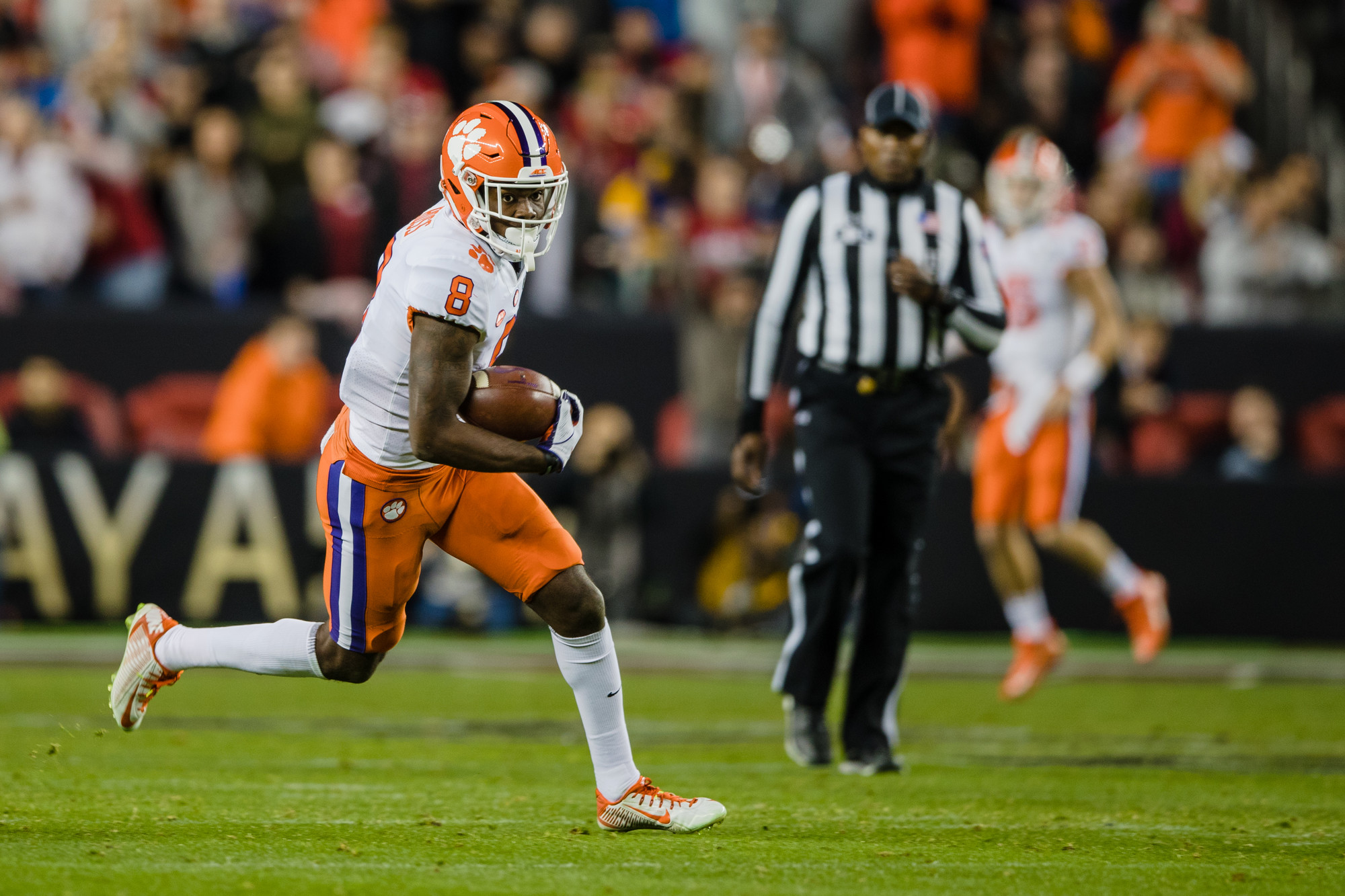 Clemson wide receiver Justyn Ross runs the ball after a reception in the second half of the CFP National Championship game at Levi's Stadium in Santa Clara, California, on Monday, Jan. 7. Clemson  beat Alabama 44-16.
