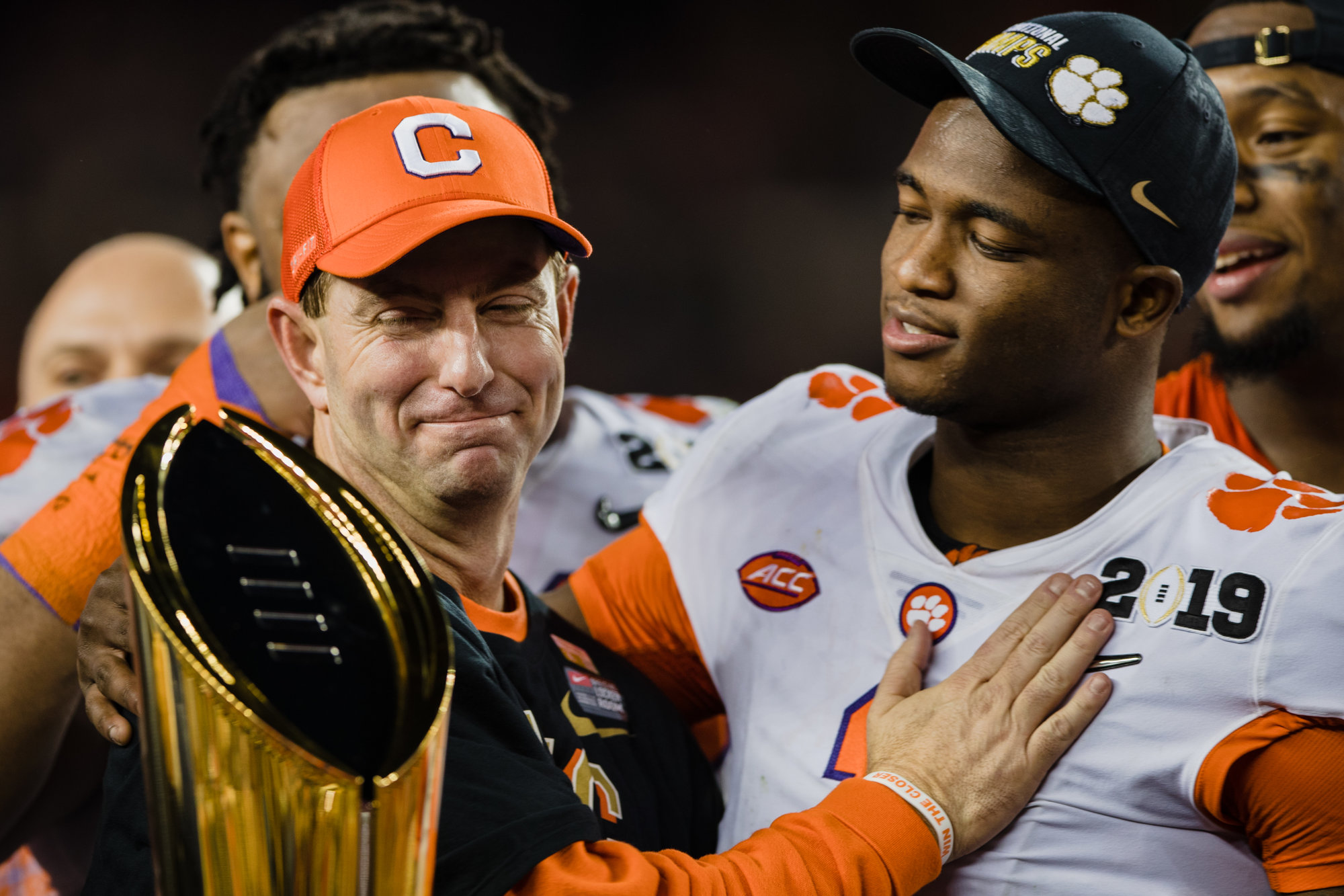Clemson head coach Dabo Swinney and cornerback Trayvon Mullen, defensive MVP for the 2019 CFP National Championship, stand with the trophy at Levi's Stadium in Santa Clara, California, on Monday, Jan. 7 after the Tigers routed Alabama 44-16 to win their second title in three years.