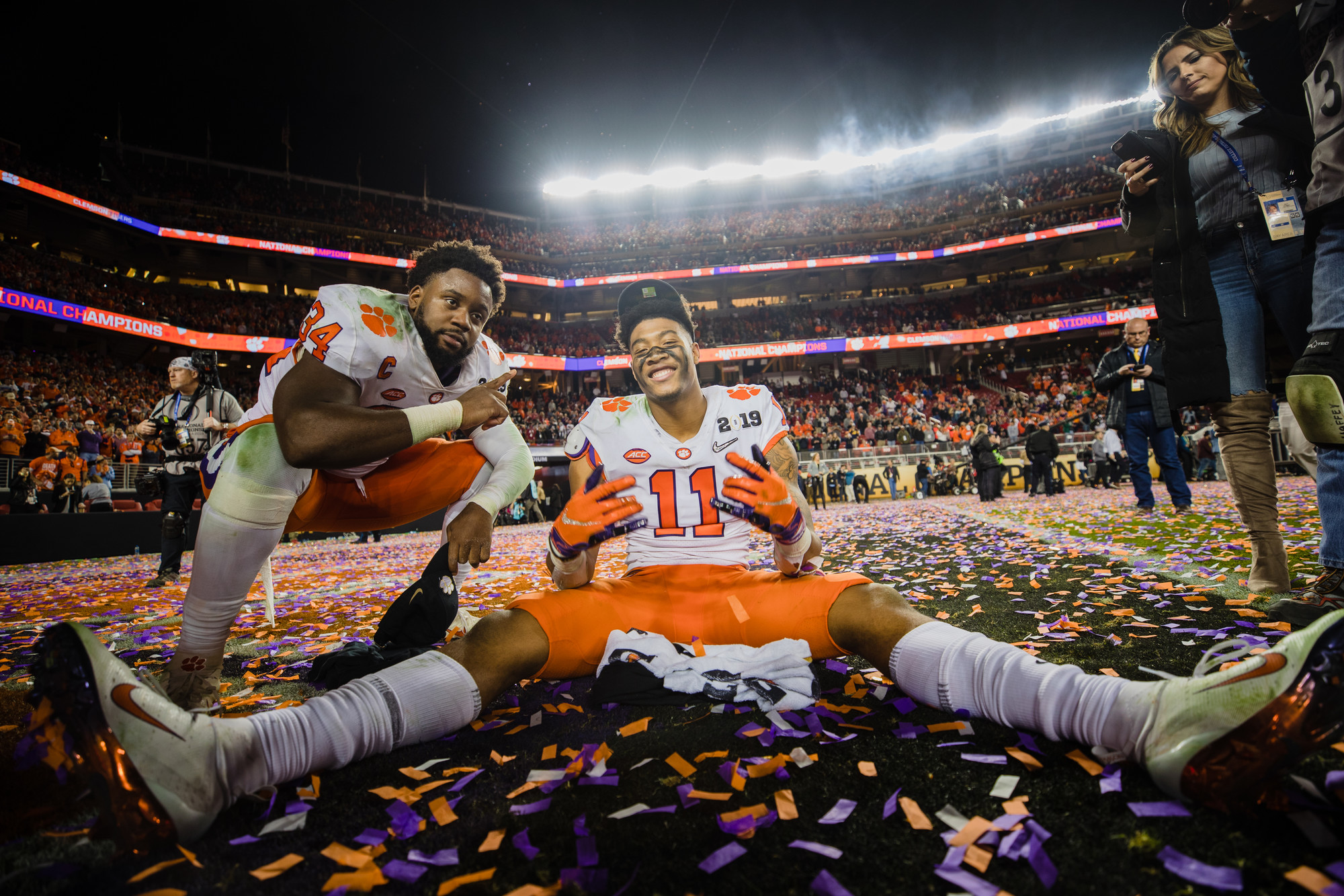Clemson safety Isaiah Simmons, center, celebrates with defensive end Justin Foster at Levi's Stadium in Santa Clara, California, on Monday, Jan. 7 after routing Alabama 44-16 to win the 2019 CFP National Championship.