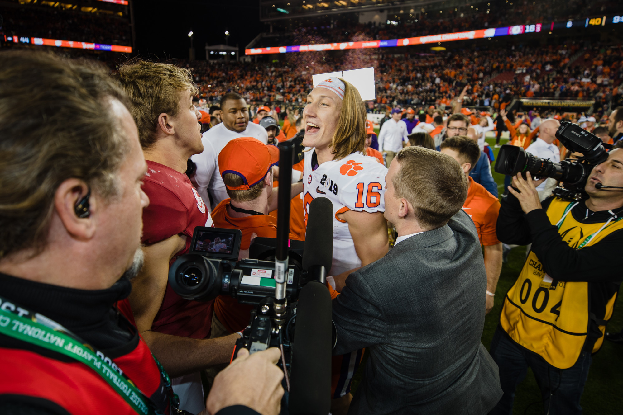 Clemson quarterback Trevor Lawrence, the game's offensive MVP, greets an Alabama player at Levi's Stadium in Santa Clara, California, on Monday, Jan. 7 after routing the Crimson Tide 44-16 to win the 2019 CFP National Championship.